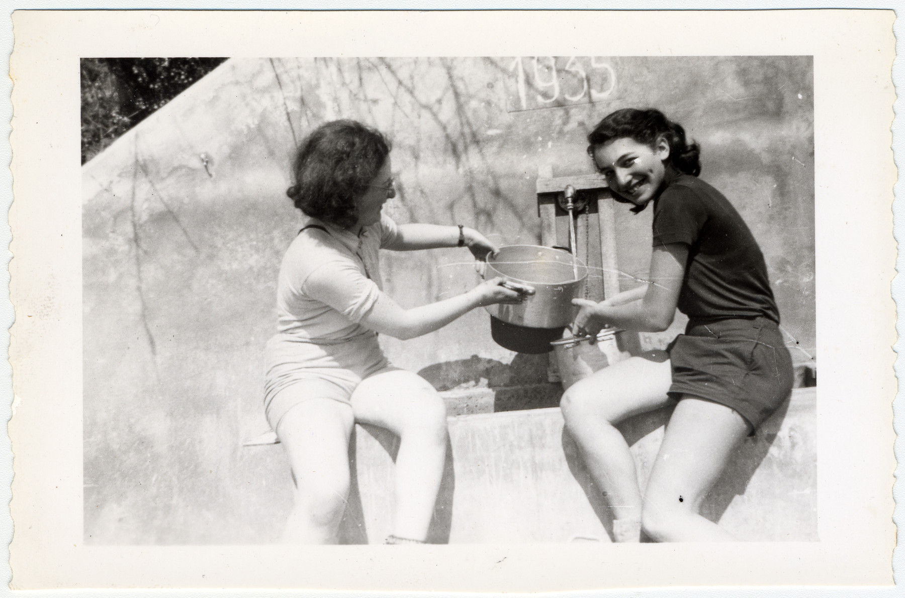 Lony Browar and Ruth Rappaport pose at the water well in Elgg, iSwitzerland.