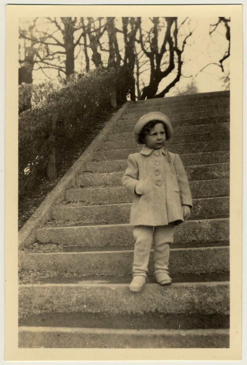 Ursi Herzog (the little girl Ruth au paired for in Zurich) stands on some outdoor steps.
