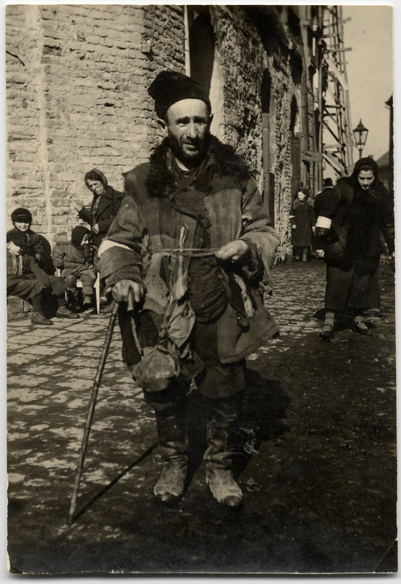 Close-up portrait of a destitute Jew on Grodzka street in the Lublin ghetto.