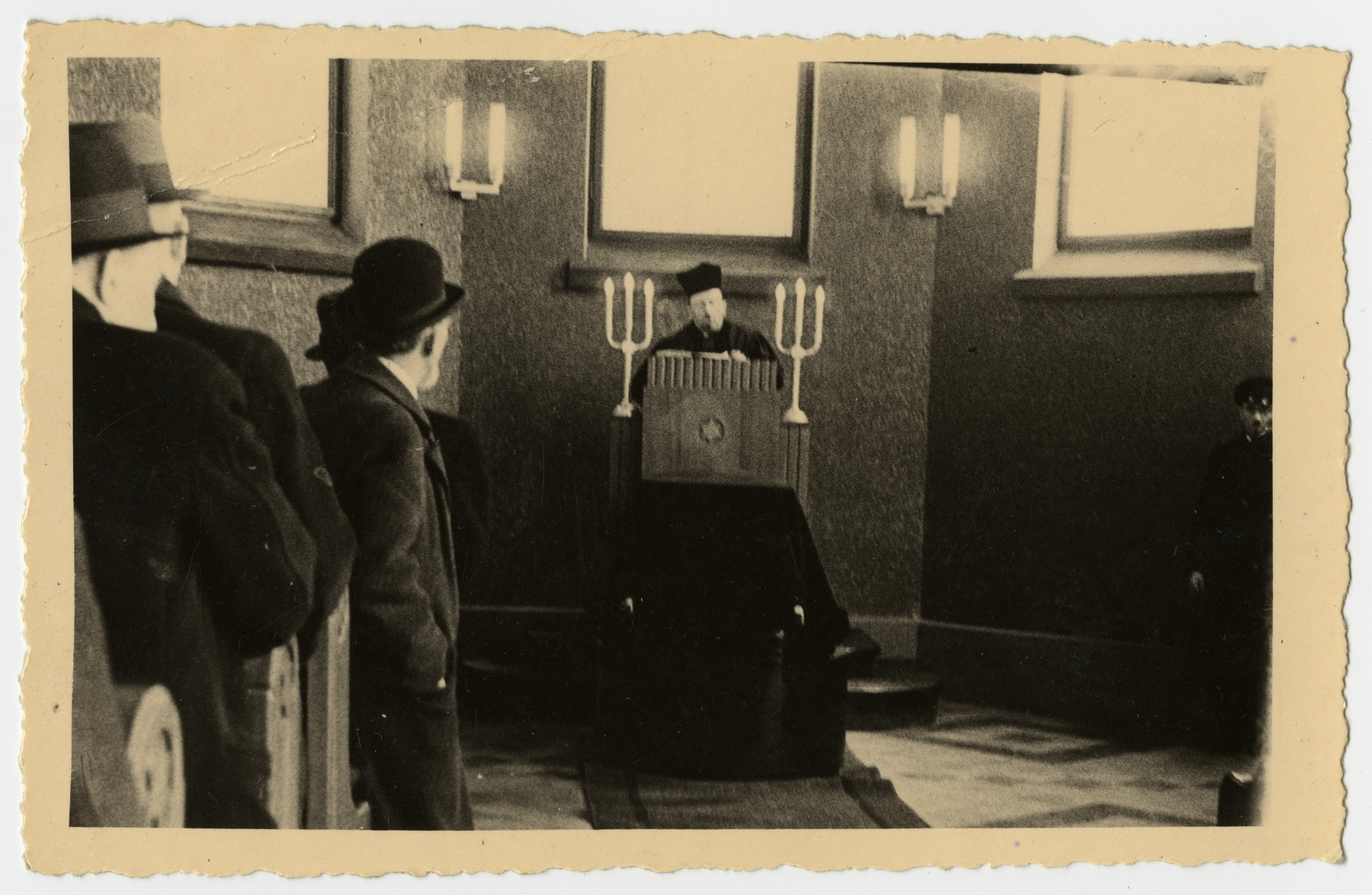 A cantor or rabbi recites prayers during the funeral of Freida Albin.