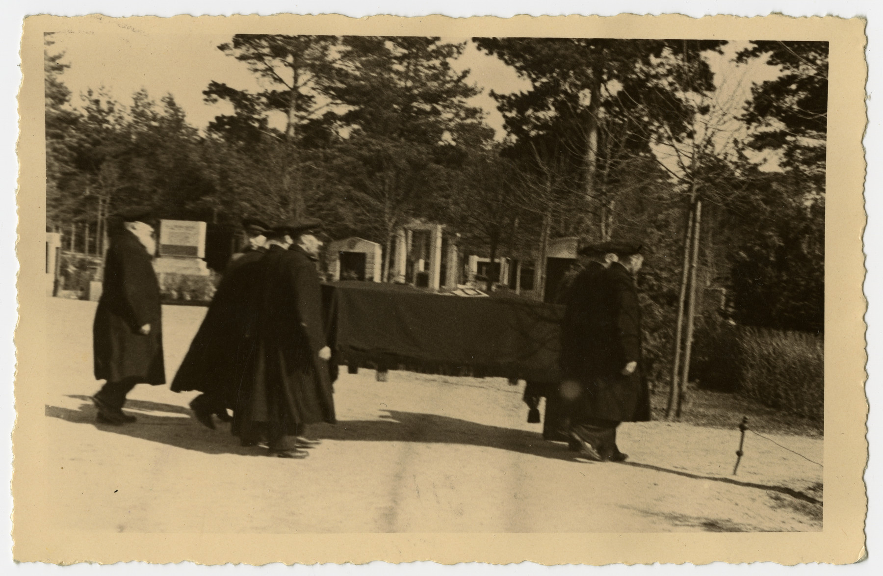 The casket holding Freida Albin is carried to the cemetery.