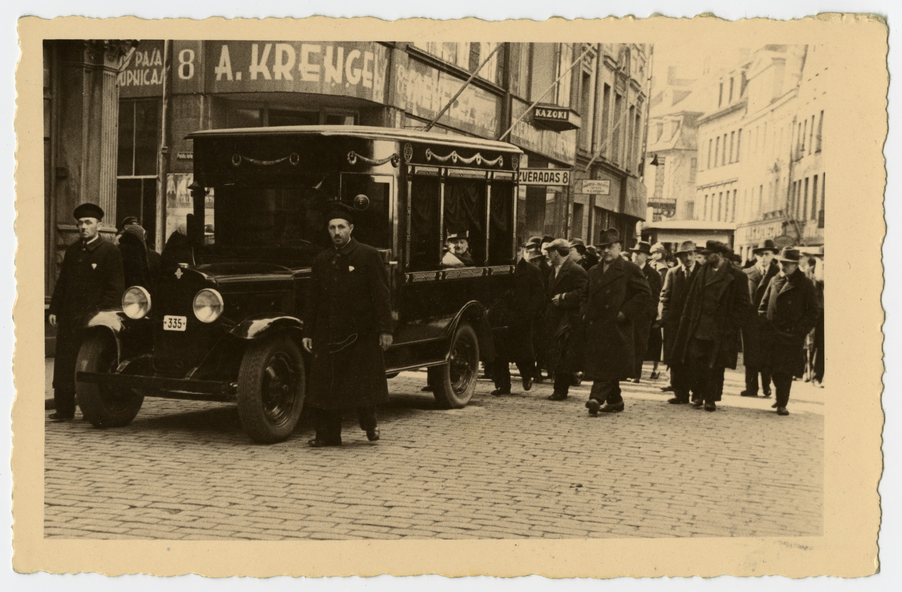 Mourners accompany the hearse carrying the body of Freida Albin prior to her funeral.    Mr. Joffee is in front and Uncle Abraham is behind the hearse.