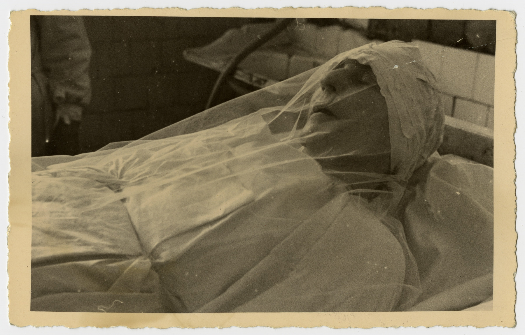 Freida Albin lies in her shrouds after the completion of her tahara (ritual purification).
