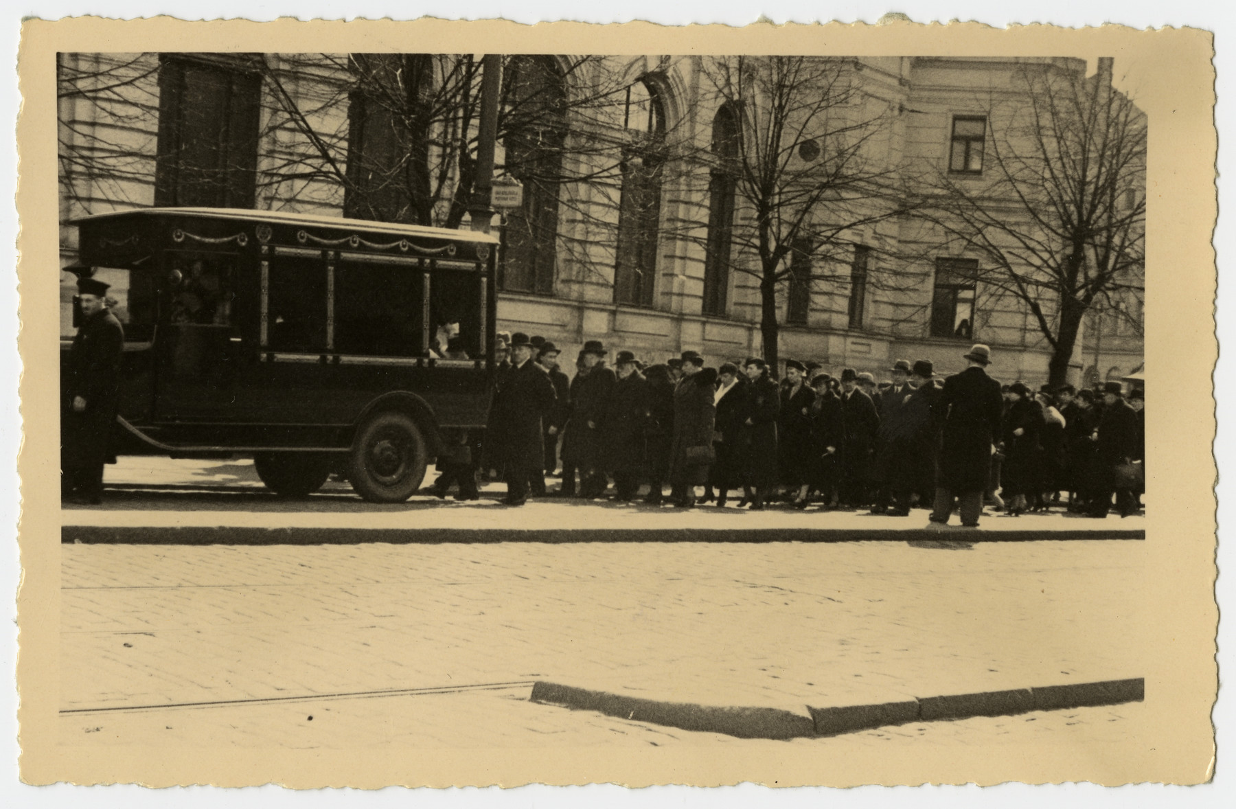 A funeral procession follows a hearse carrying the body of Freida Albin.