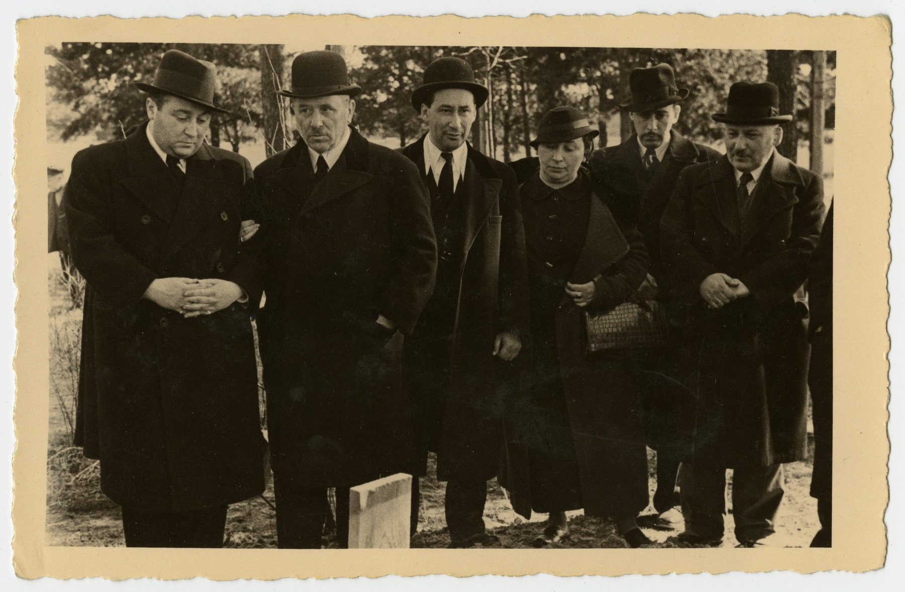 Mourners stand by the grave of Freida Albin.  Pictured are Papa, Aron, Zilla, Harri, and Abraham.