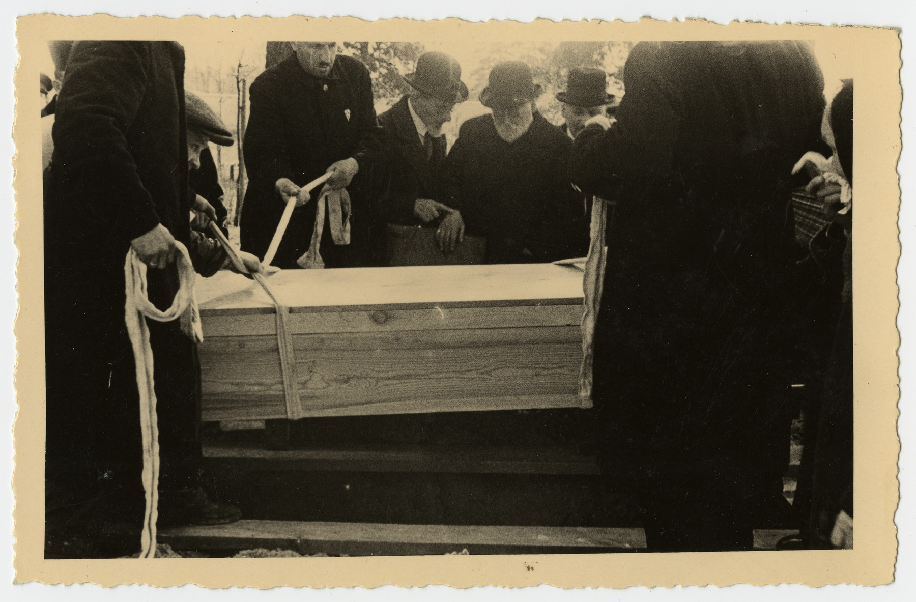 Freida Albin's coffin is lowered into her grave.