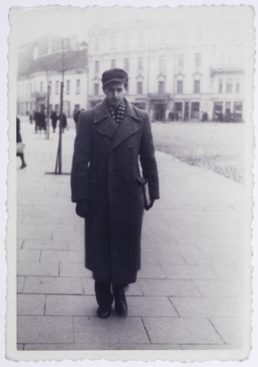 Markus Nowogrodzki poses for a photograph in the street.