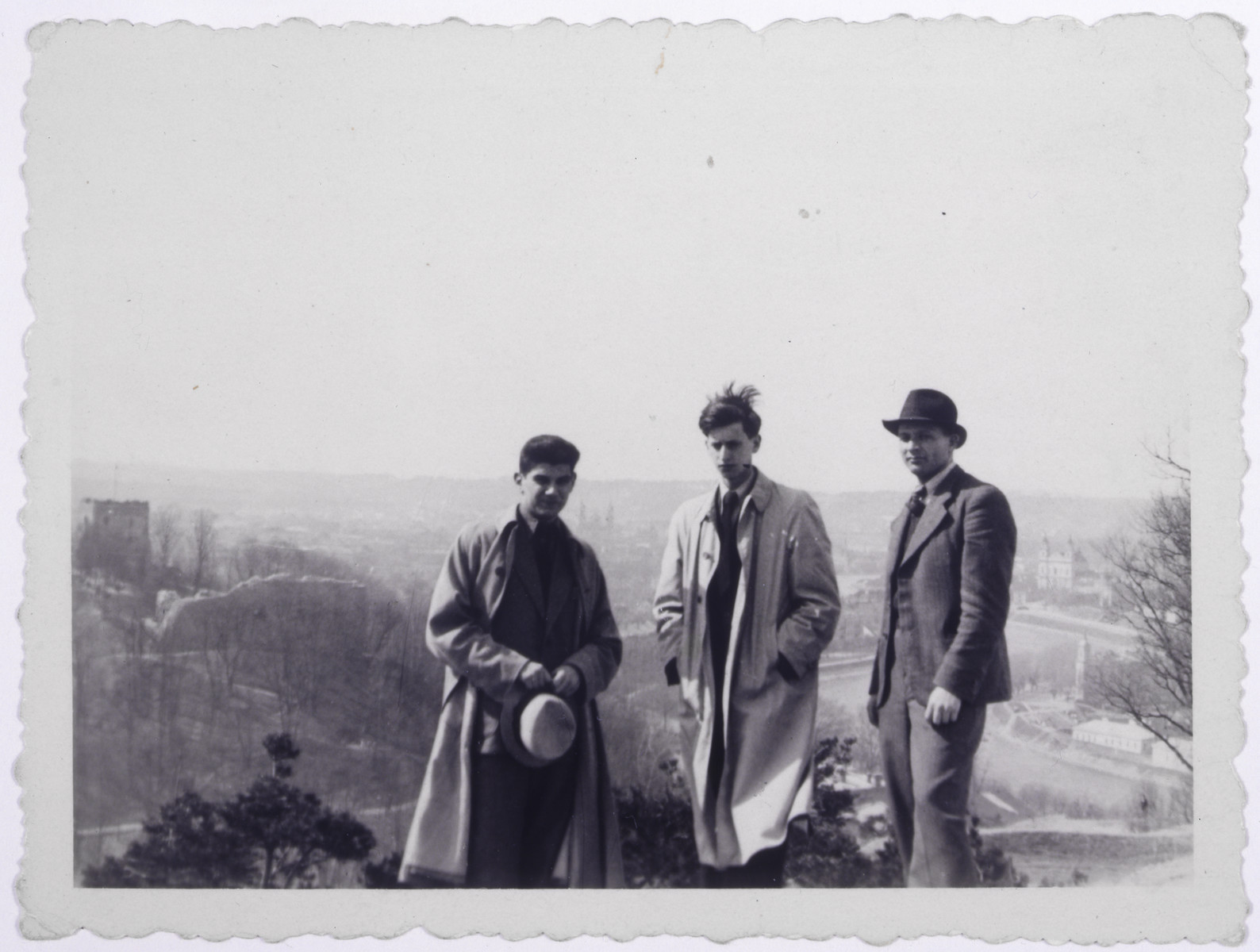 Portrait of three Jewish refugees [possibly in Vilna].  Pictured left to right are Jan Goldstein, Markus Nowogrodzki, and Mr. Shimkin.