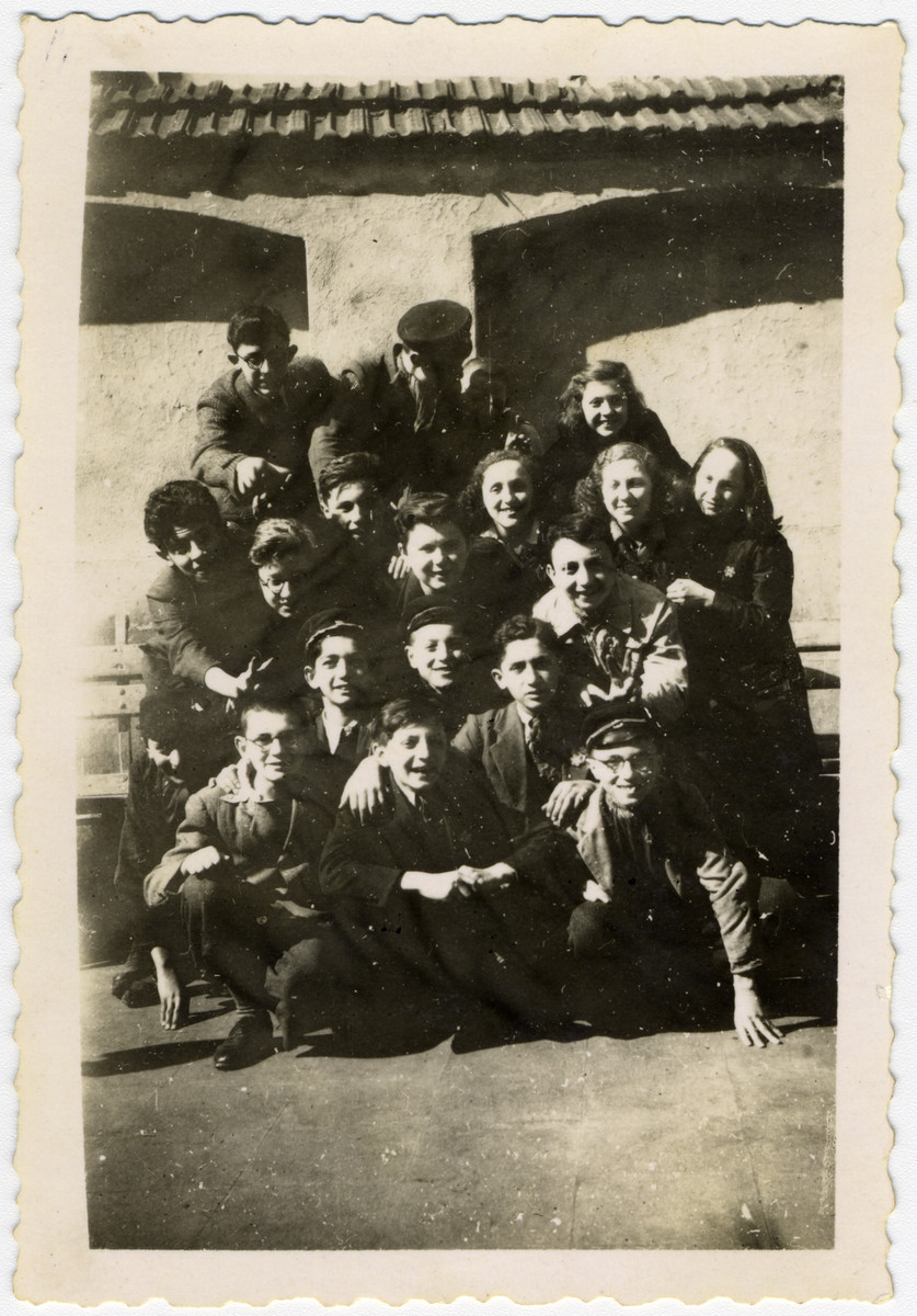 Third year students wearing Stars of David of the Hebrew middle school in Sofia pose in the synagogue courtyard.  After the German army took over the school building, classes were held in the synagogue.  Among those pictured are Albert Farhi and Israel Borouchof.  Of those pictured, five of the boys later died in Israel's War of Independence.