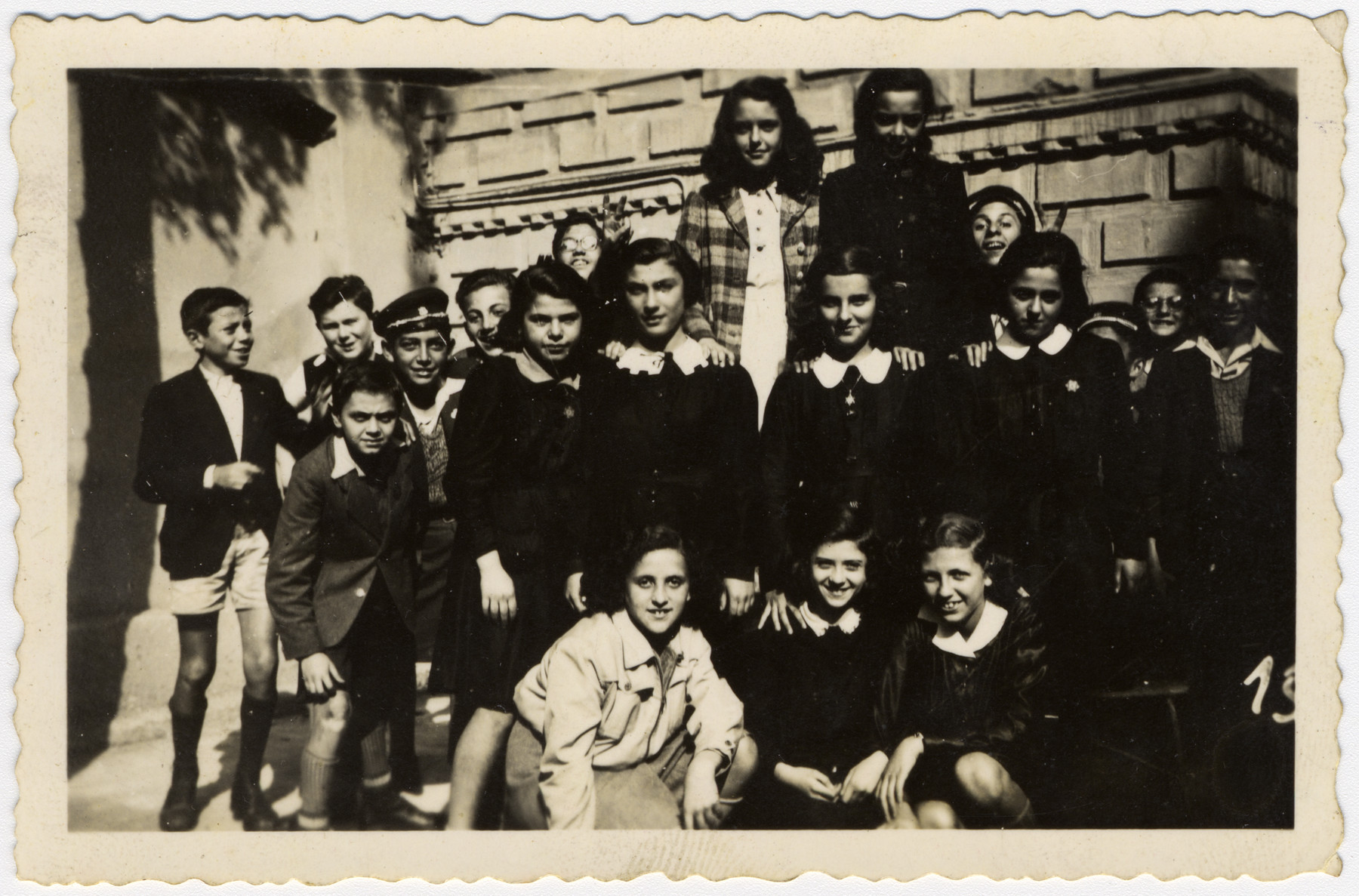 Students wearing Stars of David in the Hebrew middle school in Sofia.  After the German army took over the school building, classes were held in the synagogue.  Among those pictured are Albert Farhi and Israel Borouchof.  Of those pictured, two of the boys later died in Israel's War of Independence.
