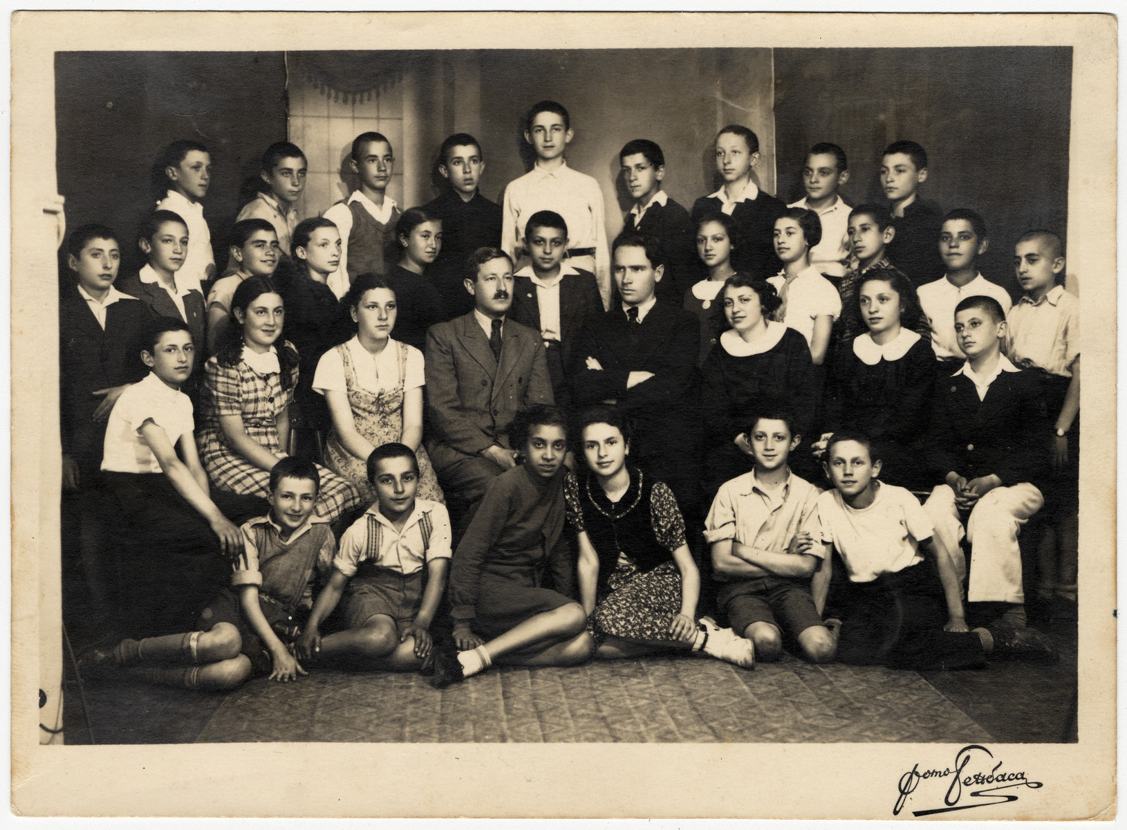 Class portrait of the Hebrew School in Sofia.  David Farhi is seated on the far right.  The principal Cohen is seated in the center with a mustache.