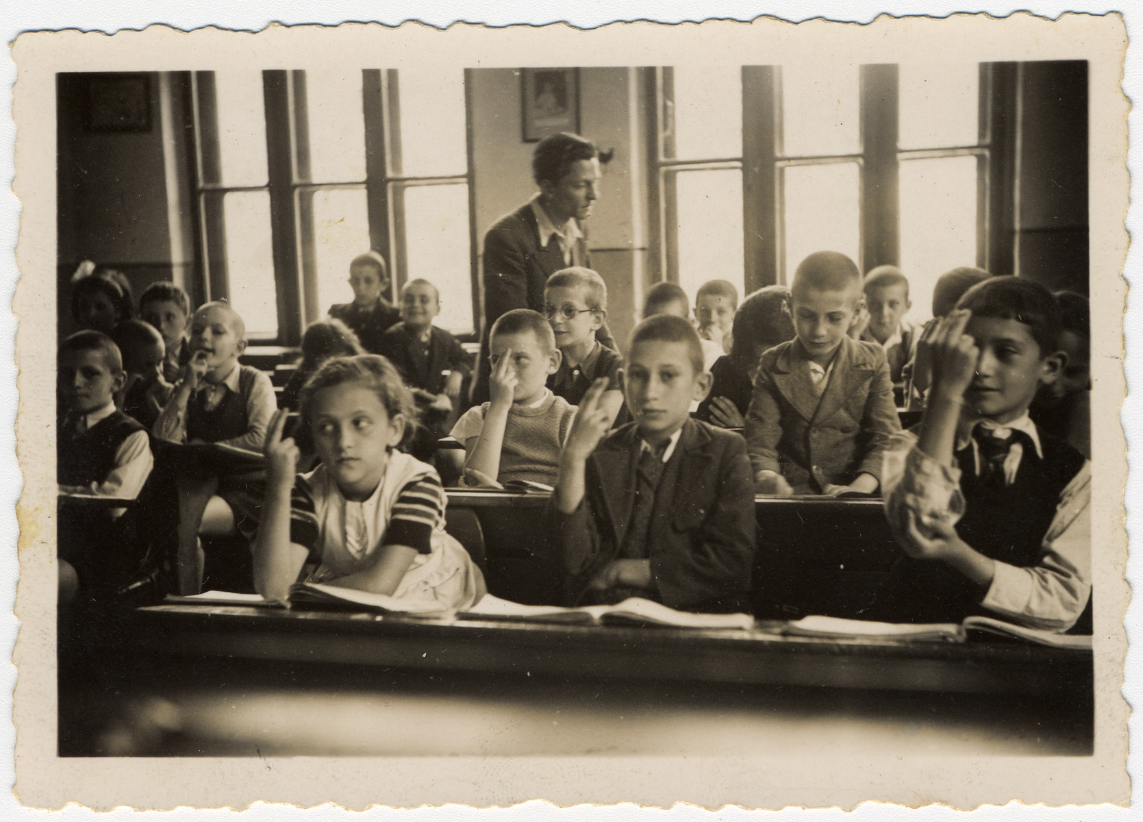 Students sit at their desks in the Hebrew school in Sofia.  Among those pictured is Albert Farhi and the teacher, Mr. Peretz.
