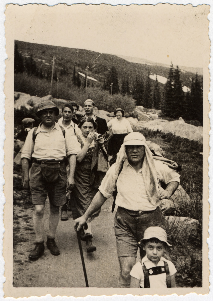 A Bulgarian Jewish family goes for a hike in a forest.  Moise Farhi is in the front.  His father Nissim is on the left, and his mother Caroline is in the back of the group.