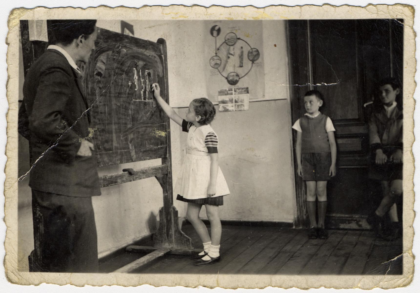 Mr. Peretz teaches a math class in the Sofia Hebrew School.