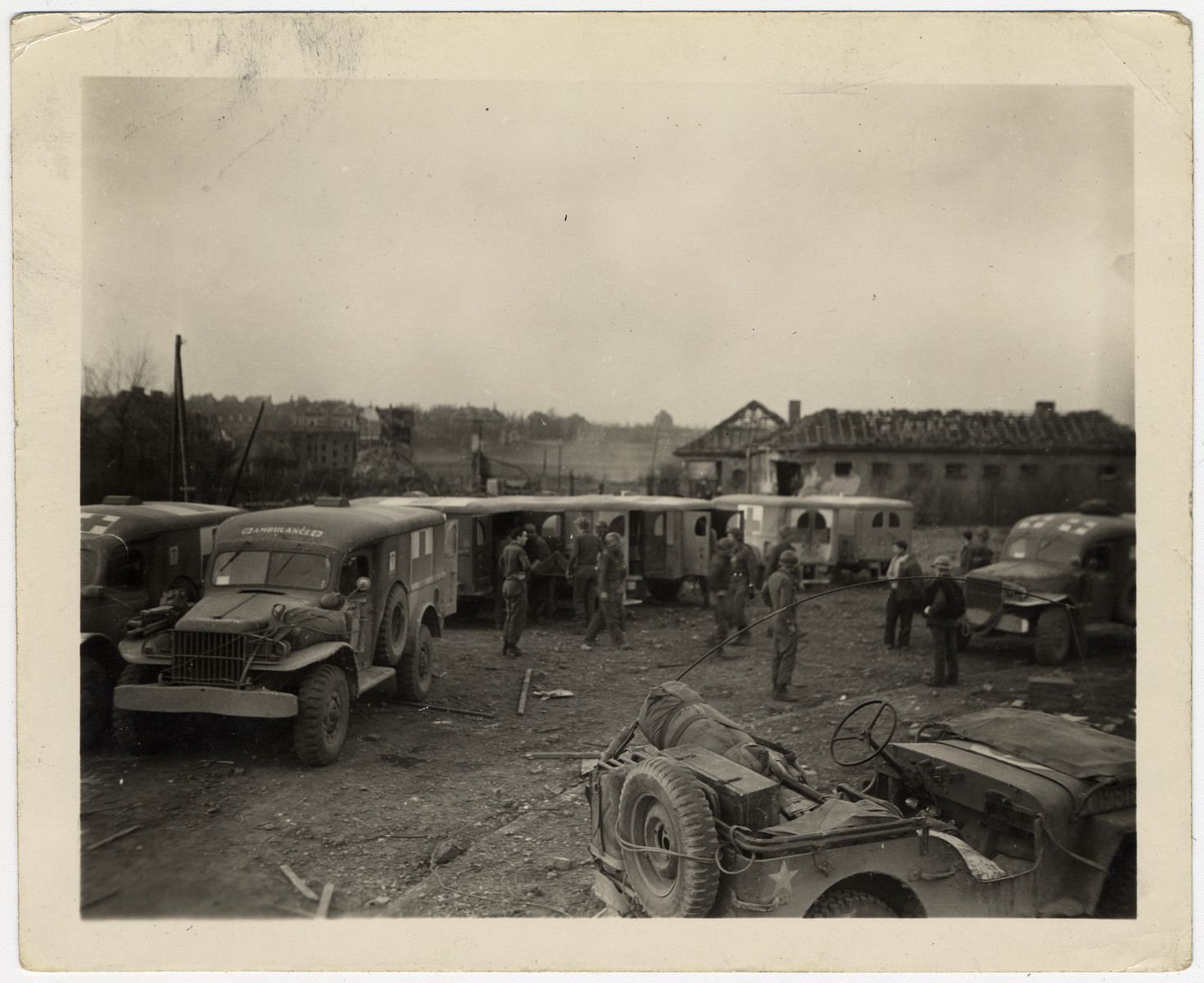 Trucks and ambulances line up to evacuate survivors of the Nordhausen concentration camp.