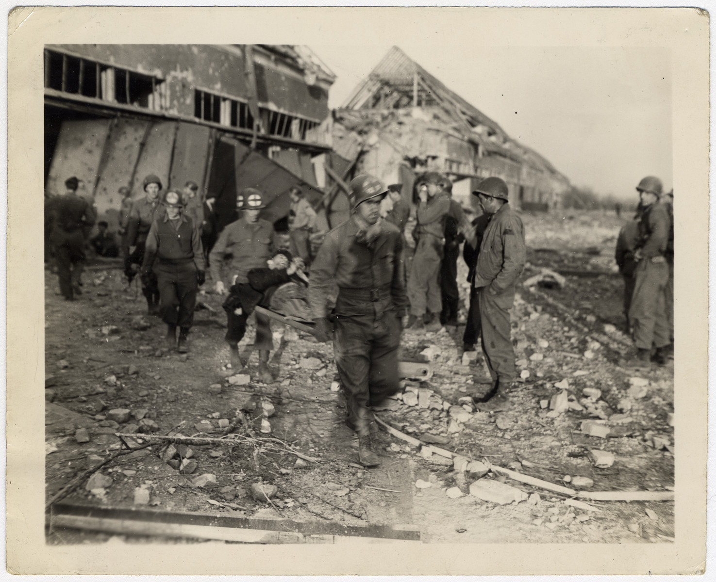 American medics evacuate survivors from the rubble of the Nordhausen concentration camp.