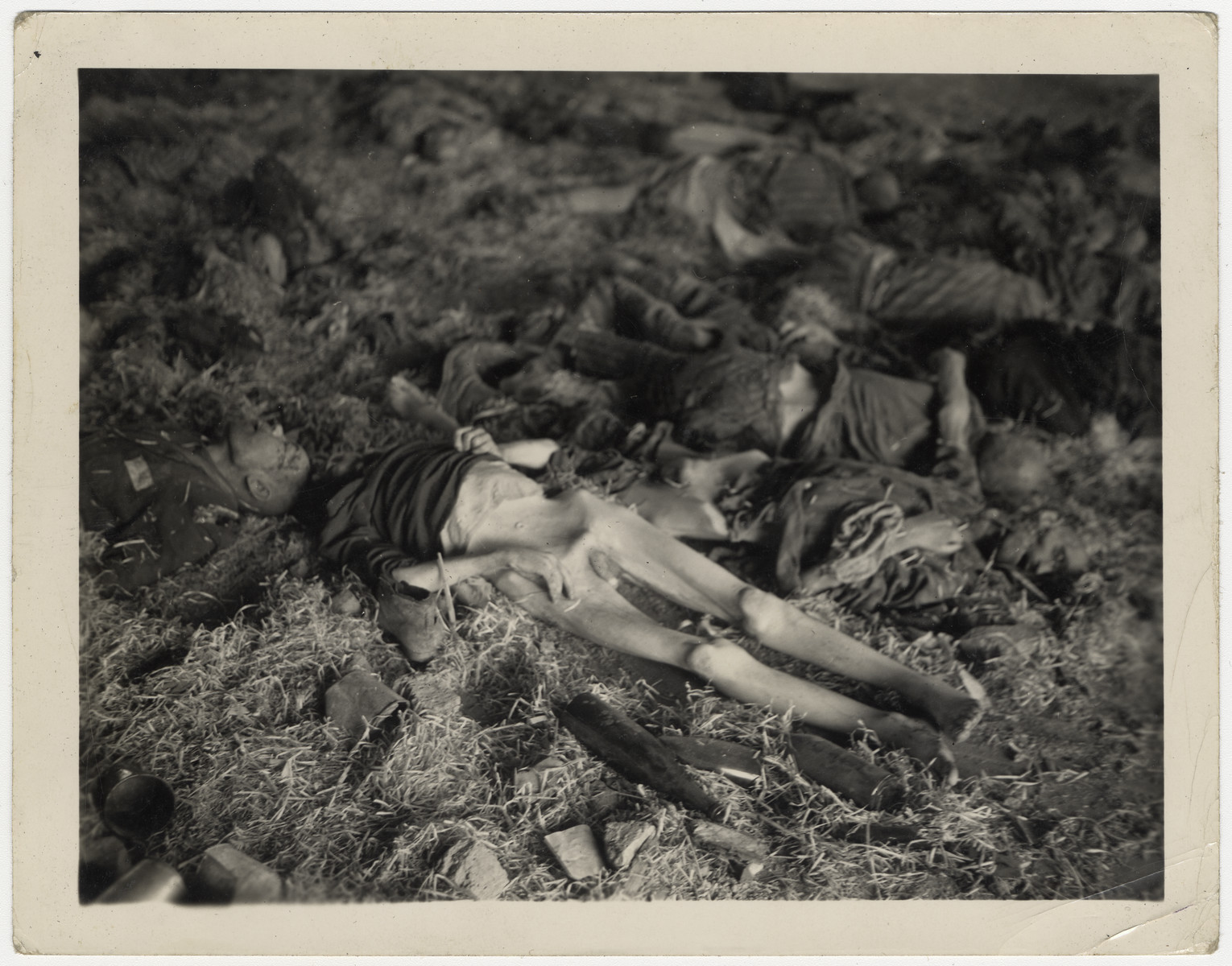 Corpses of victims lie on the straw floor of a barrack of the Nordhausen concentration camp.