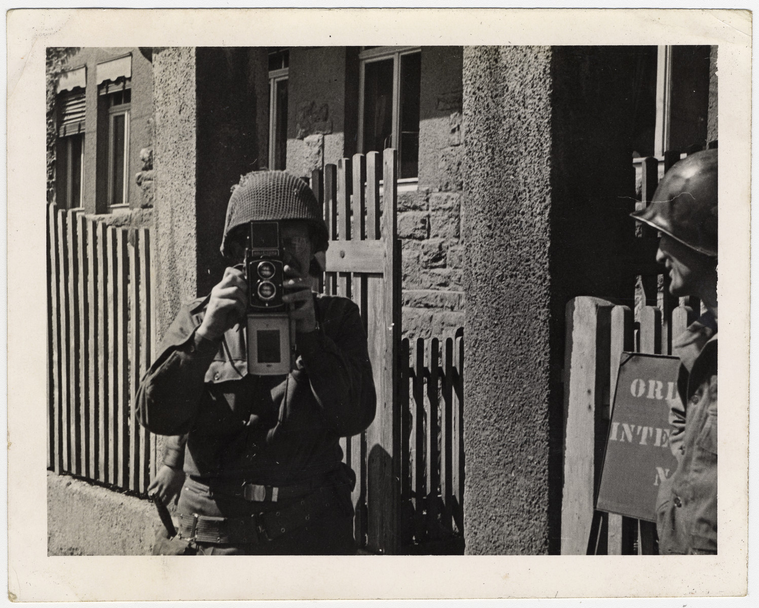 Self-portrait of U.S. Army photographer William Bostwick Curtis taking a picture with his camera.
