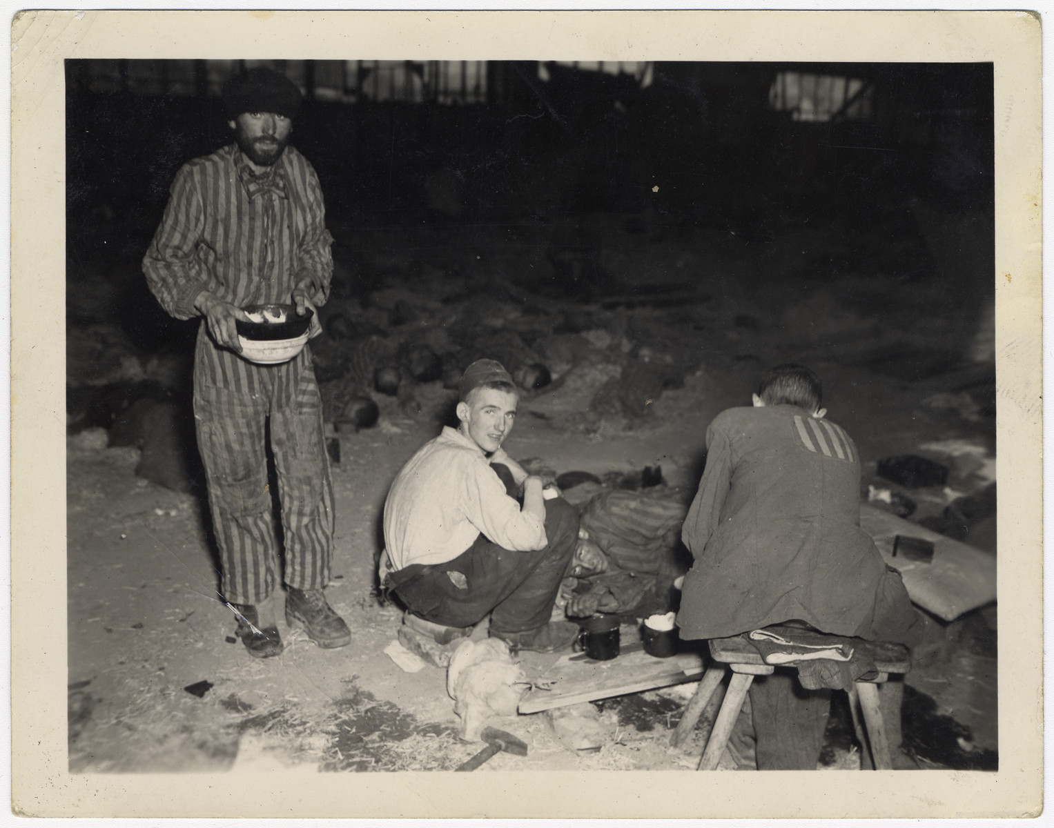 Three survivors gather in a barrack of the Nordhausen concentration camp.