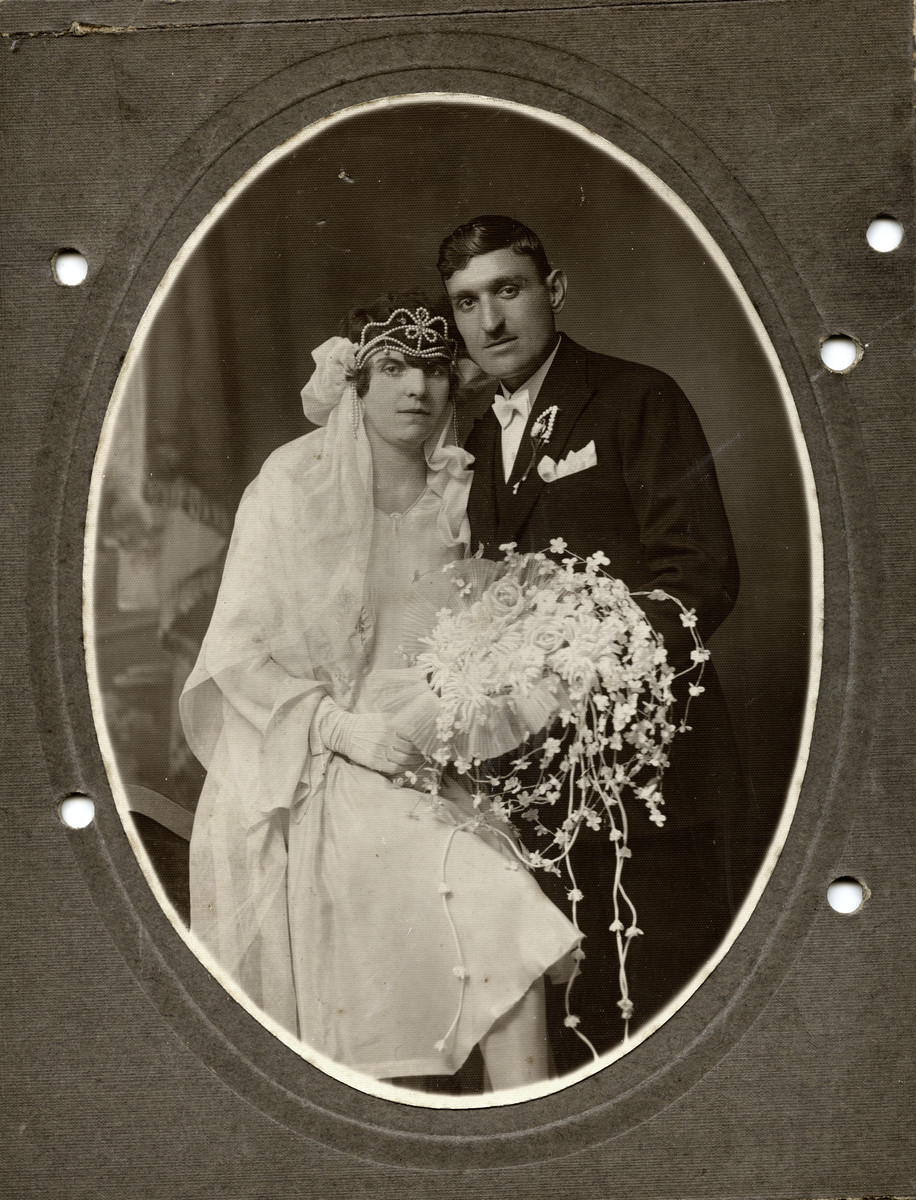 Studio wedding portrait of Rachamin Behar and Rachel Cohen.