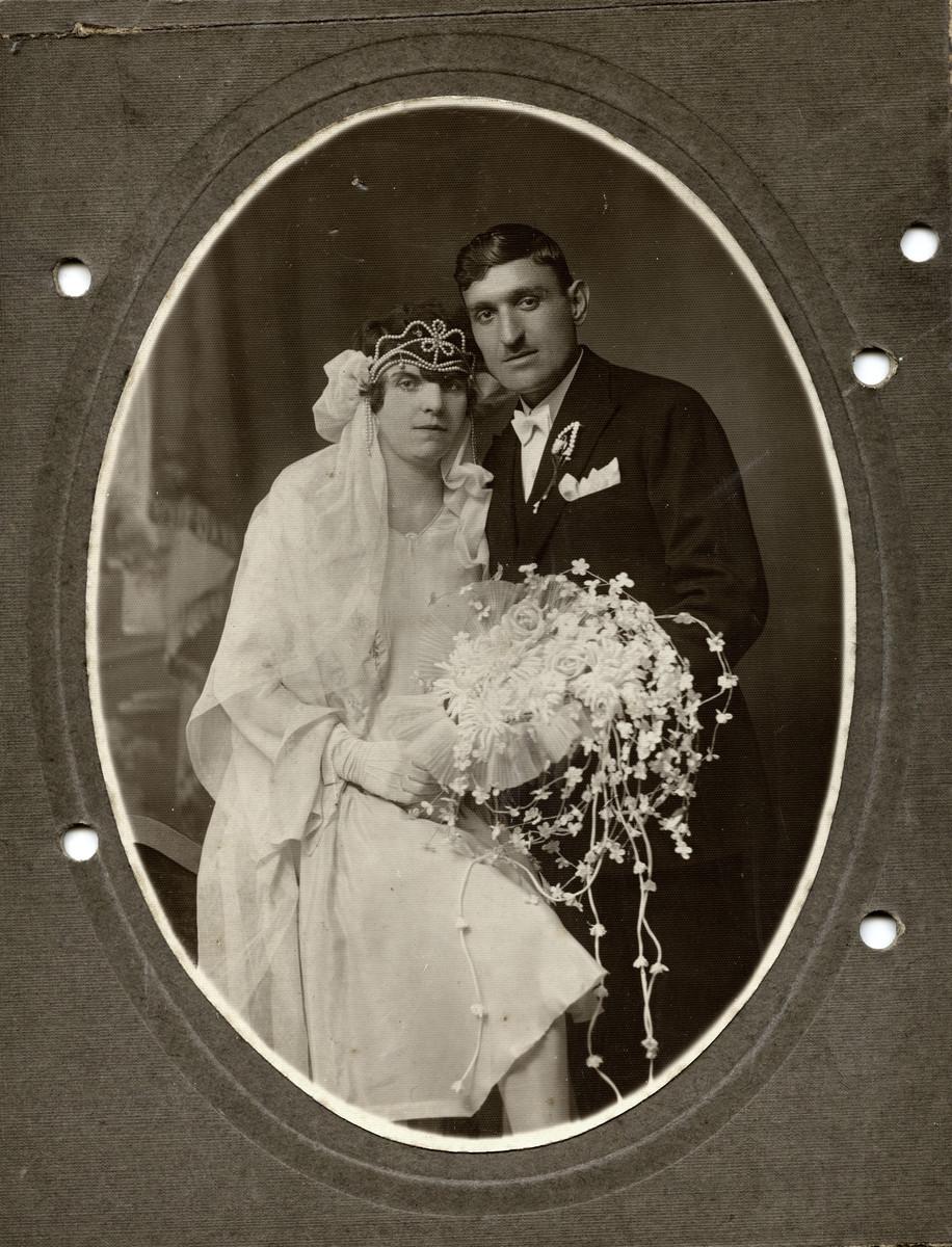 Studio wedding portrait of Rachamin Behar and Rachel Cohen.