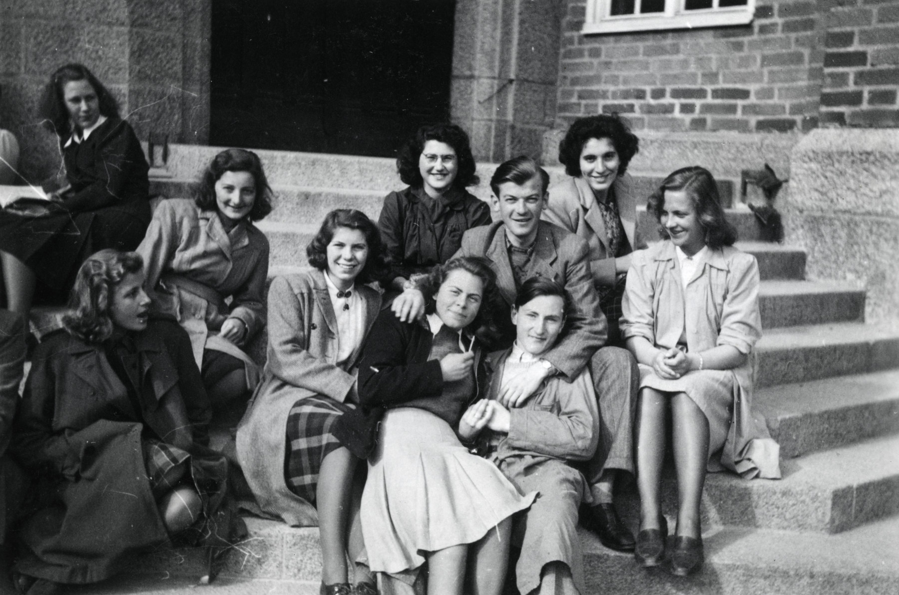 Students in the Norwegian high school in Uppsala, Sweden.  Some are Norwegian Jewish refugees.  Among those pictured are Celia Century (top, center wearing a dark shirt), Rahel (Tulla) Blomberg (right) and Dagfinn Bernstein (front).