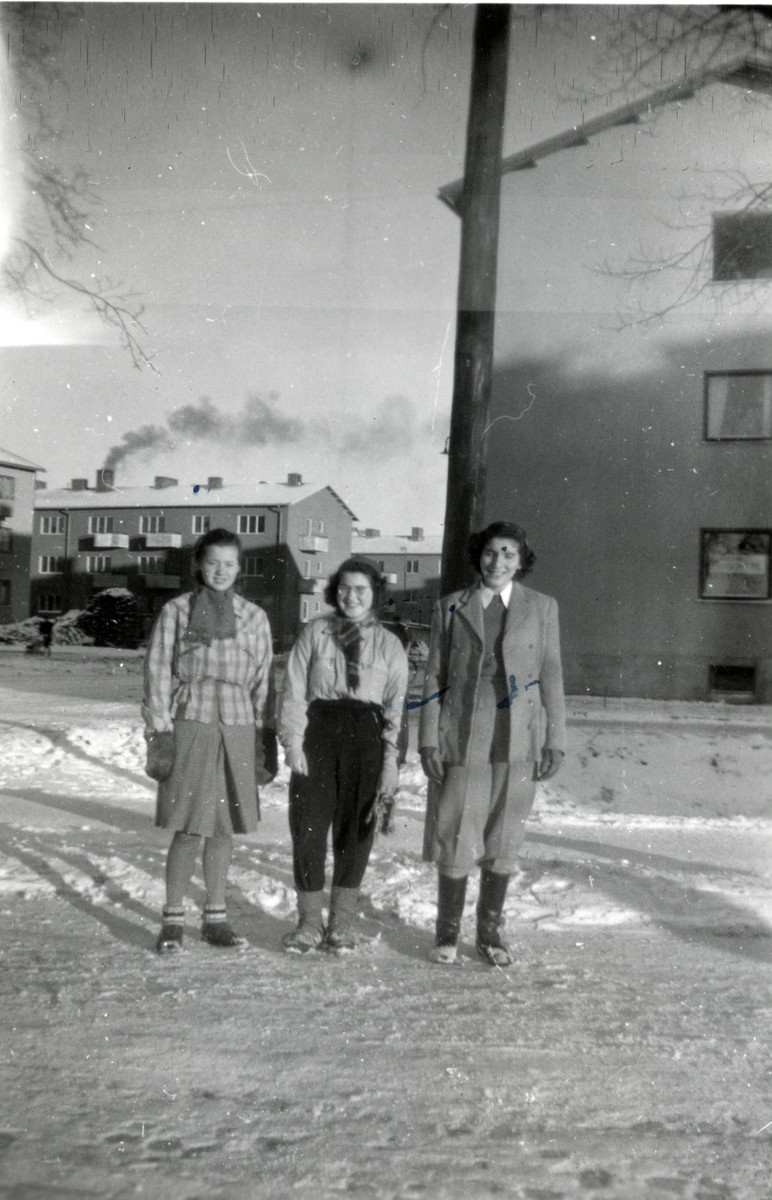 Celia Century stands in front her family's house in Uppsala together with two friends.   Also pictured is Rahel (Tulla) Blomberg.