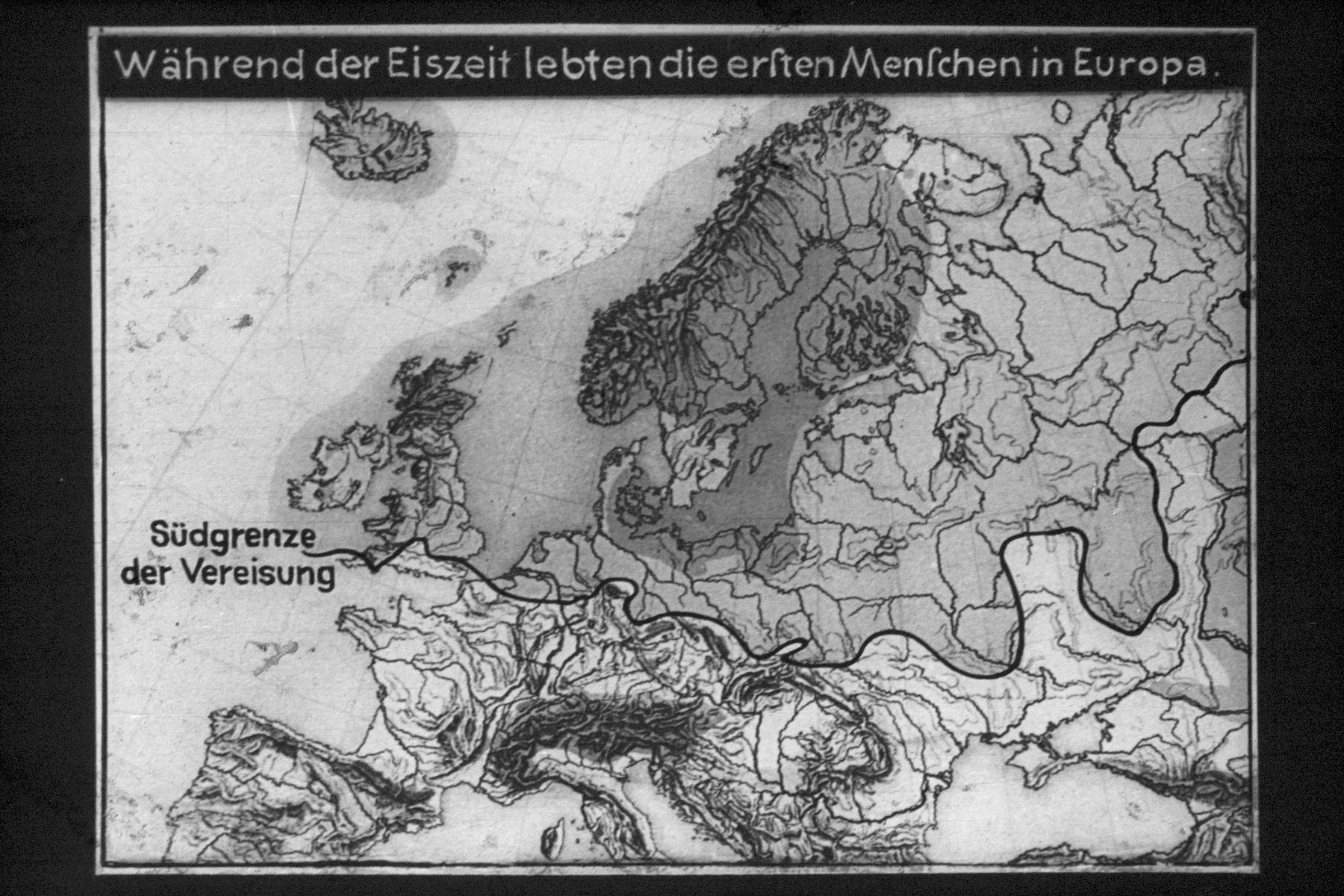 "4th Nazi propaganda slide for a Hitler Youth educational presentation entitled ""5000 years of German Culture.""  Während der Eiszeit lebten die ersten Menschen in Europa  During the Ice Age, the first humans lived in Europe"