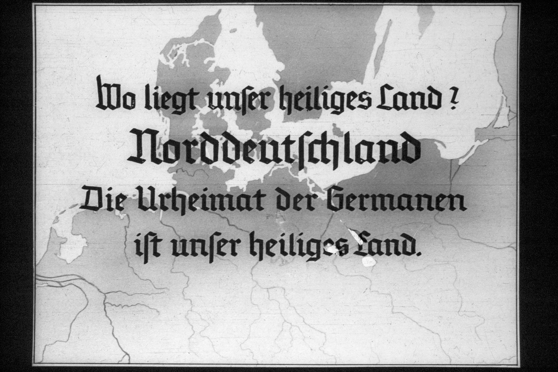 "7th Nazi propaganda slide for a Hitler Youth educational presentation entitled ""5000 years of German Culture.""  Wo liegt unser heiliges Land? Norddeutschland Die Urheimat der Germanen ist unser heiliges Land. // Where is our holy land? Northern Germany The original homeland of the Germans is our sacred land."
