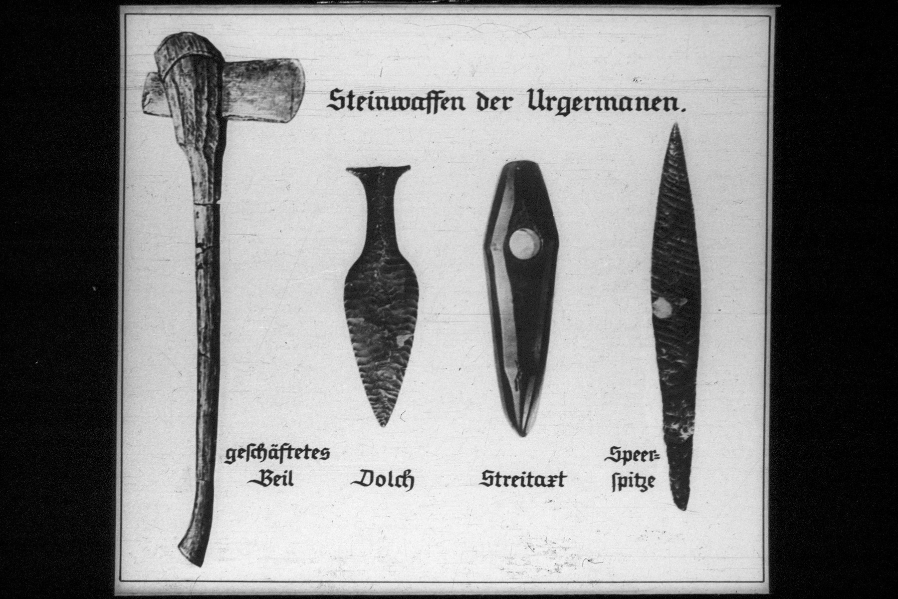 "10th Nazi propaganda slide for a Hitler Youth educational presentation entitled ""5000 years of German Culture.""  Steinwaffen der Urgermanen. // Stone weapons of the Proto-Germanic era."