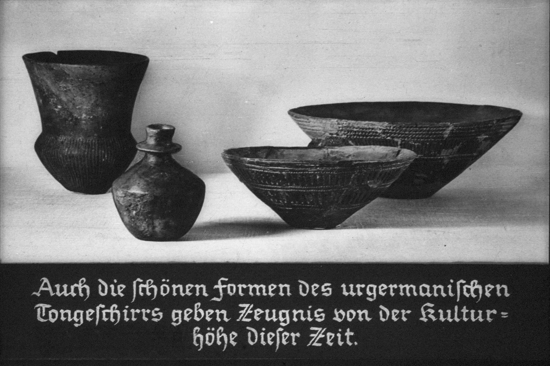 "11th Nazi propaganda slide for a Hitler Youth educational presentation entitled ""5000 years of German Culture."" Auch die schönen formen des urgermanischen Tongeschirrs geben Zeugnis von der Kulturhöhe dieser Zeit. // The beautiful shapes of the Primitive Germanic pottery give evidence of the cultural height of this period."