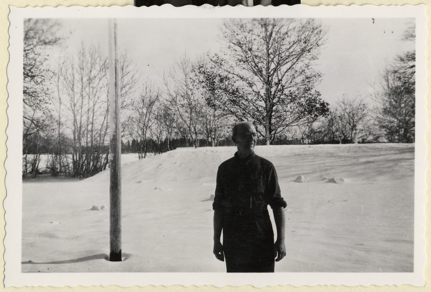 Karel Kasak, a Czech political prisoner in Dachau, stands outside in the snow outside the grounds of the camp.