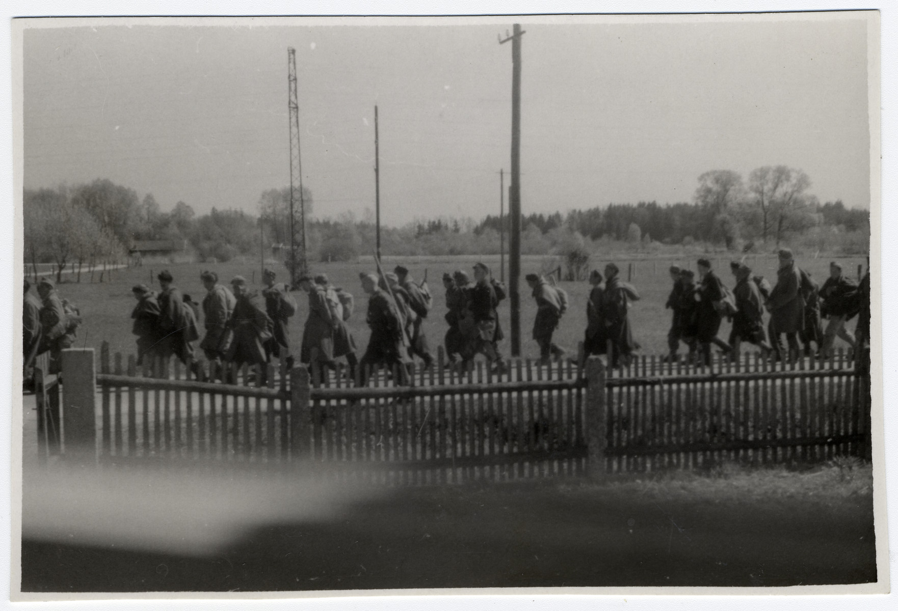 Clandestine photograph taken by Maria Seidenberger from the window of her family's home of German SS men and soldiers marching away from the Dachau concentration camp, the day before it was liberated.  The photo was taken from the second story window of her family's home.