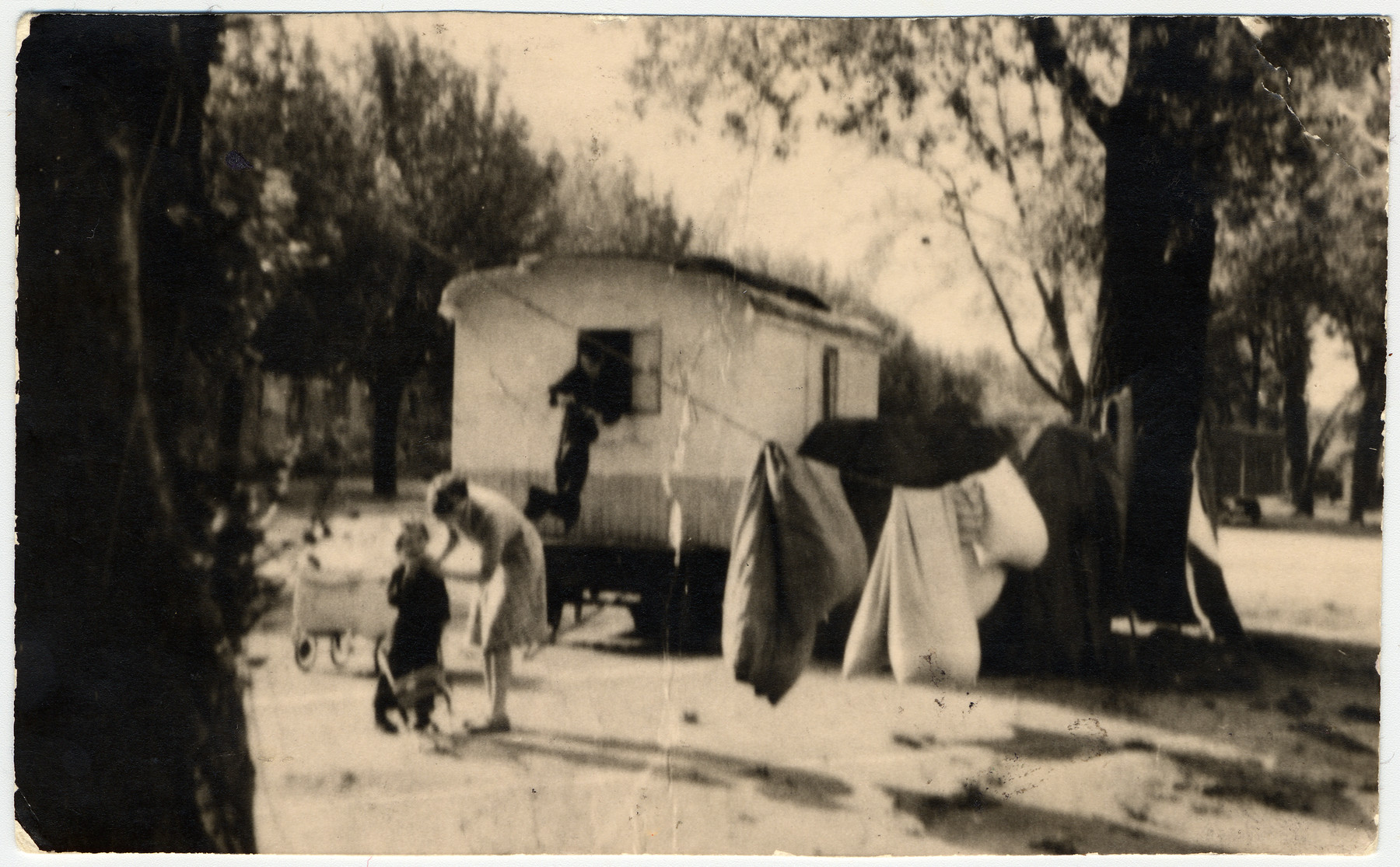 A woman takes care of her child in a Sinti (Gypsy) camp in Germany.   Pictured is Theresia Seibel with her daughter Rita.  At the window is donor's aunt, Nelka.