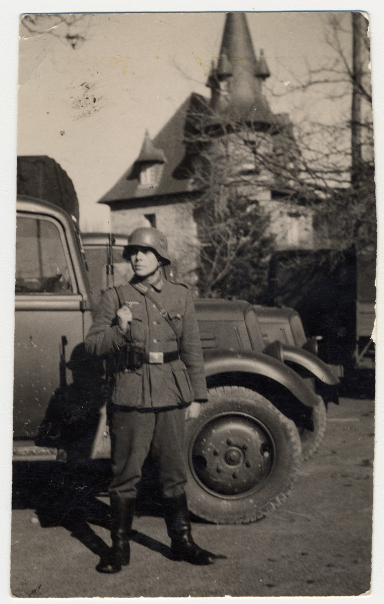 A German soldier stands guard in front of a castle.   Pictured is Kurt Winterstein a member of the donor's family.  He was one of Hitler's personal drivers.  When the Nazis found out that his mother was Gypsy they took him out of the army and sterilized him.