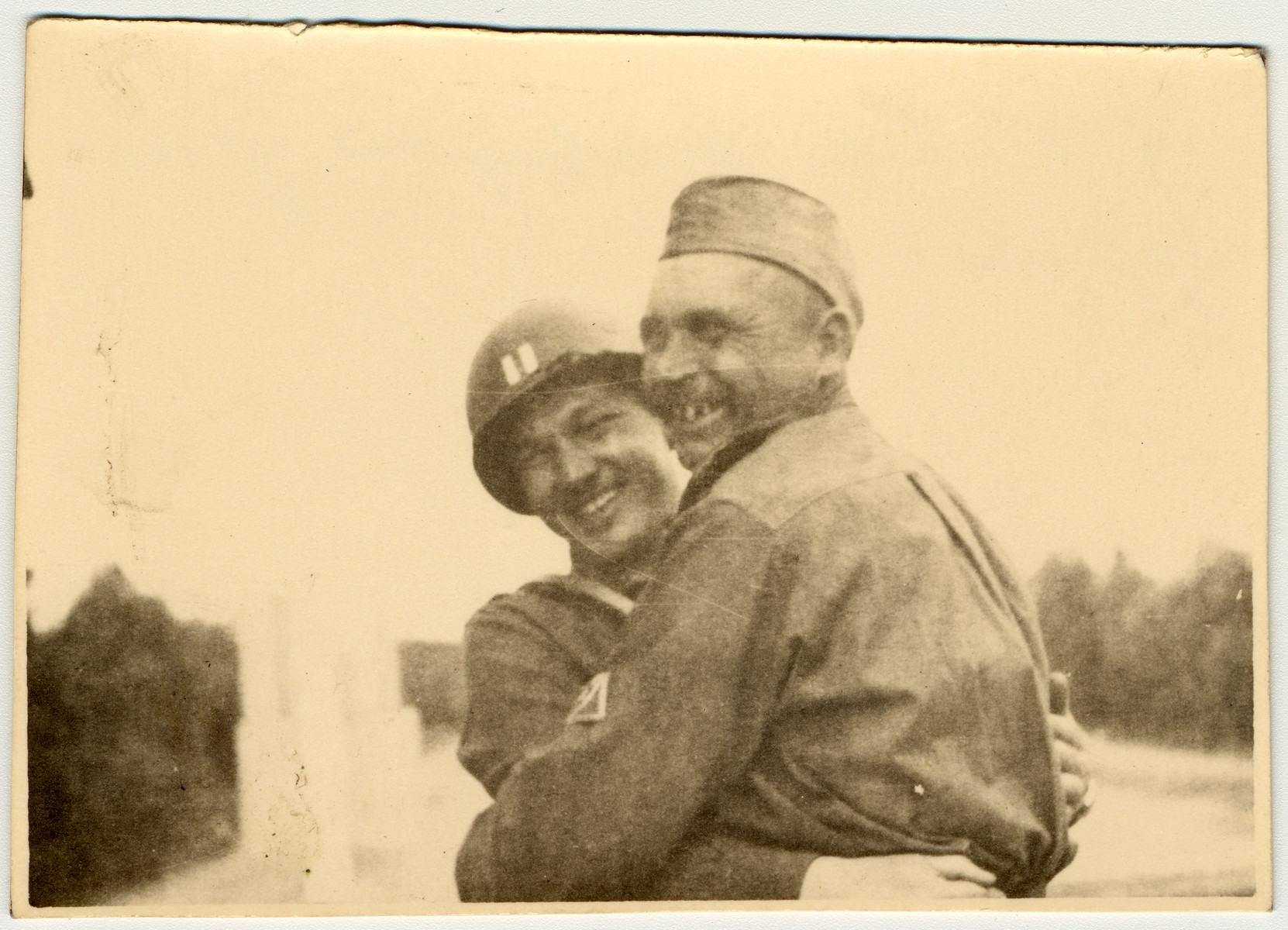 American and Russian soldiers share a hug for the camera.