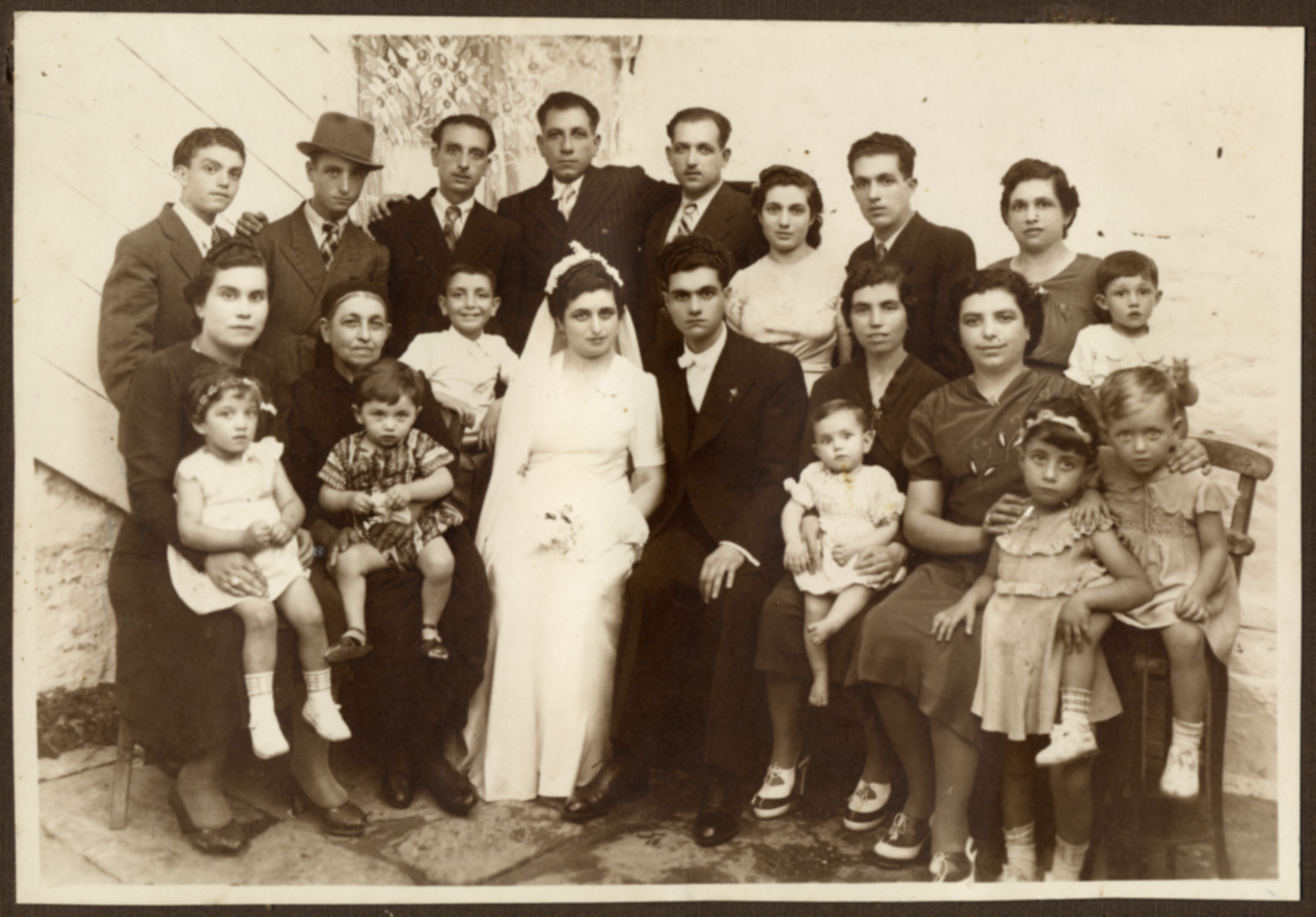 Wedding portrait of an extended Jewish family in Greece.  Pictured is the Vitalis family.  Everyone perished except for Rosa Vitalli Ackou and her five children.