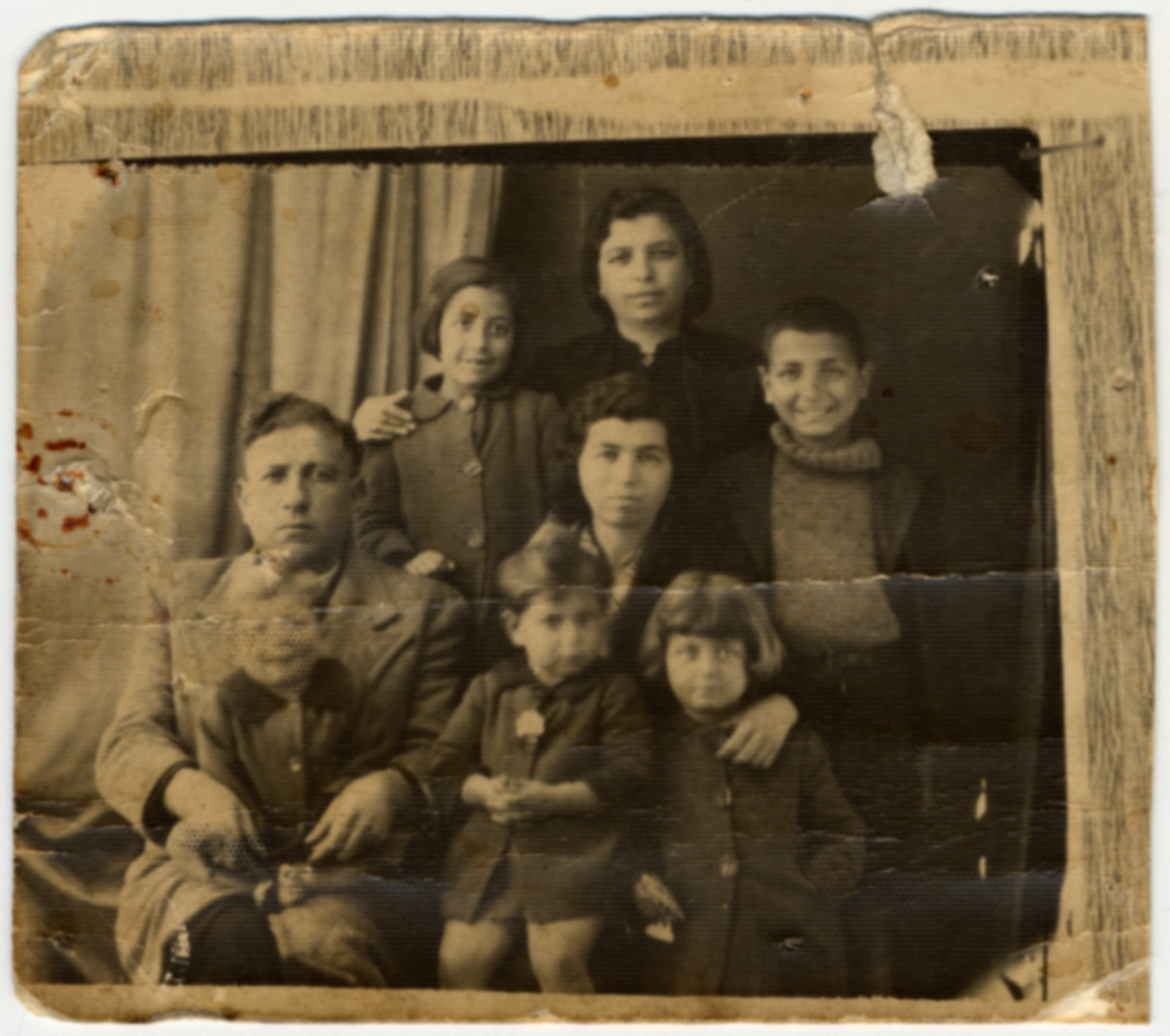 Group prewar portrait of a Greek Jewish family.  Pictured is the Ackos family