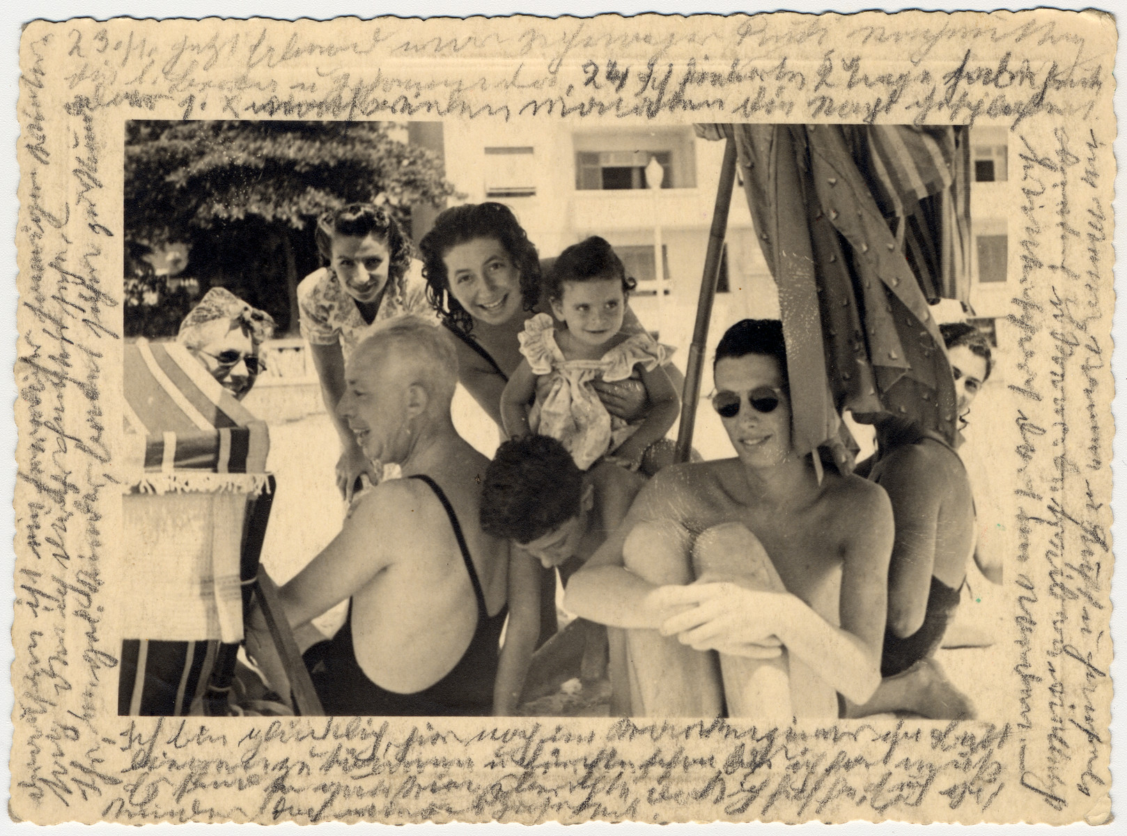 Photograph representing family members of Helene Reik and their friends gathered together in March 1941 in Brazil.    The photograph was sent to Helene Reik who used it as paper for her diary in the Theresienstadt ghetto.   The baby in the middle is Helene's Reik granddaughter Margarida Reik (now Margarida Lane Reik de Frankel), born in February 1939, and the boy on whose back she's seating is named Valerio.  Margarida's mother Charlotte is in the back.