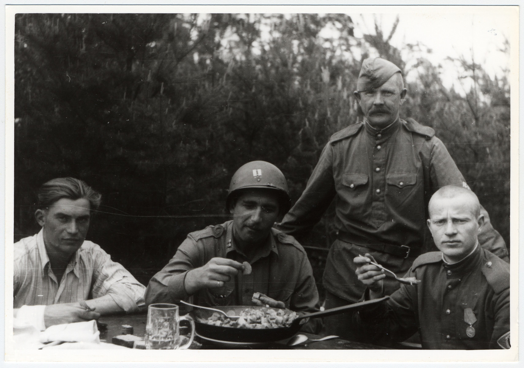 American and Russian soldiers share a meal.  Among those pictured is the donor, Louis Drucker.