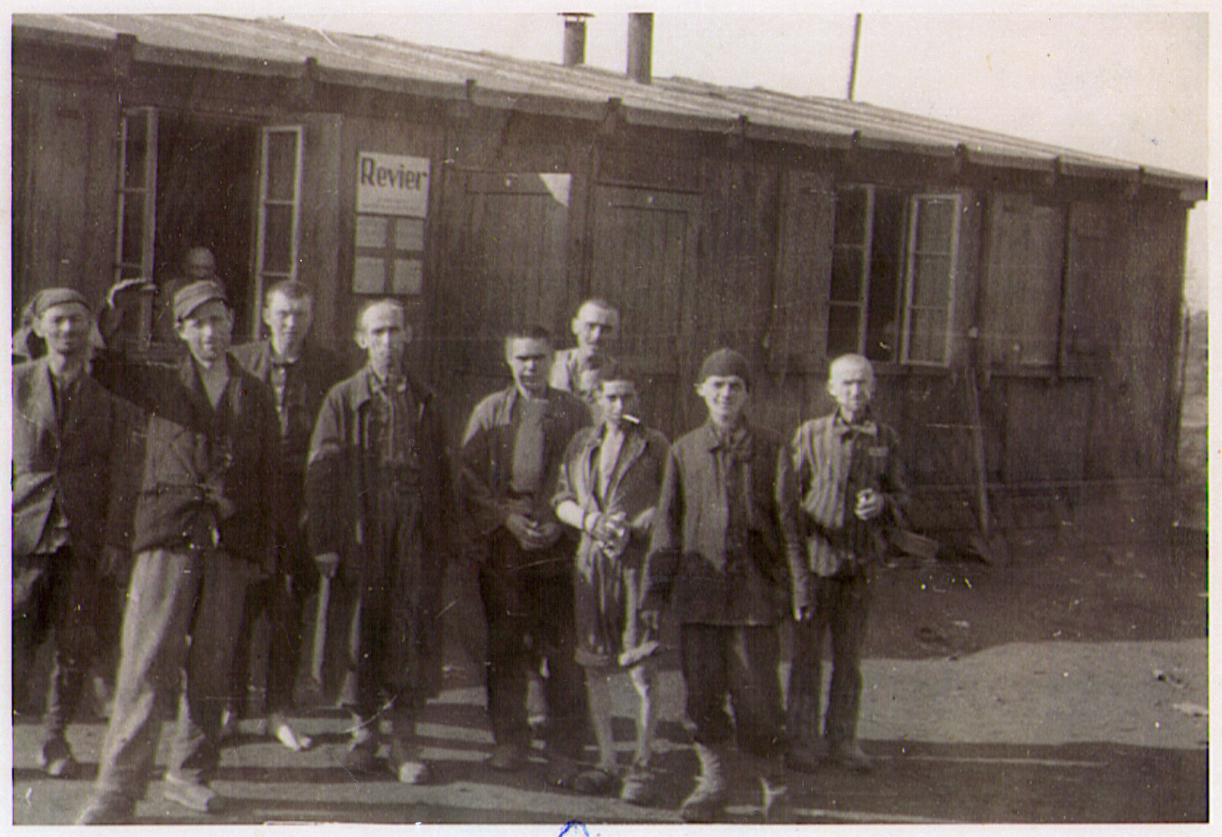 A group of survivors of the Hanover-Ahlem concentration camp gather outside of the infirmary.