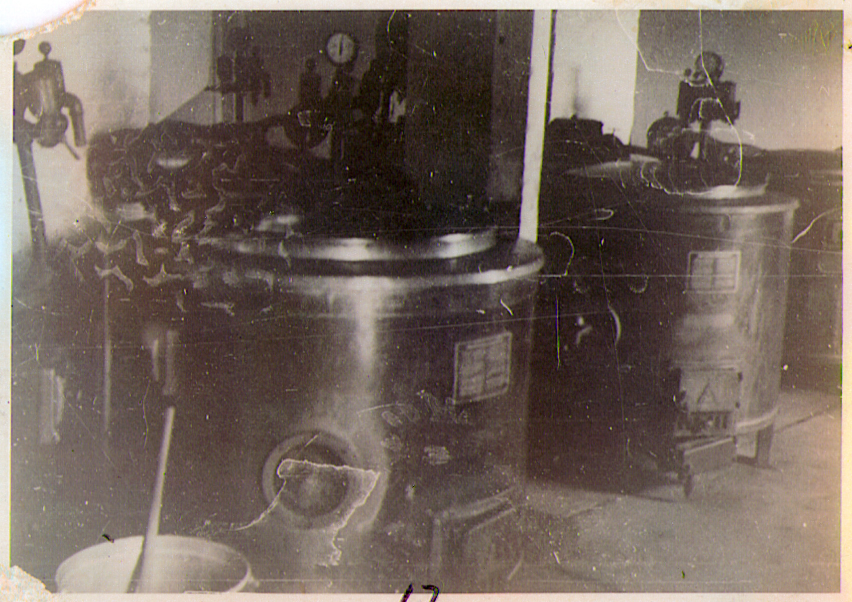 View of two large vats in the interior of an unknown building in th Hanover-Ahlem concentration camp.