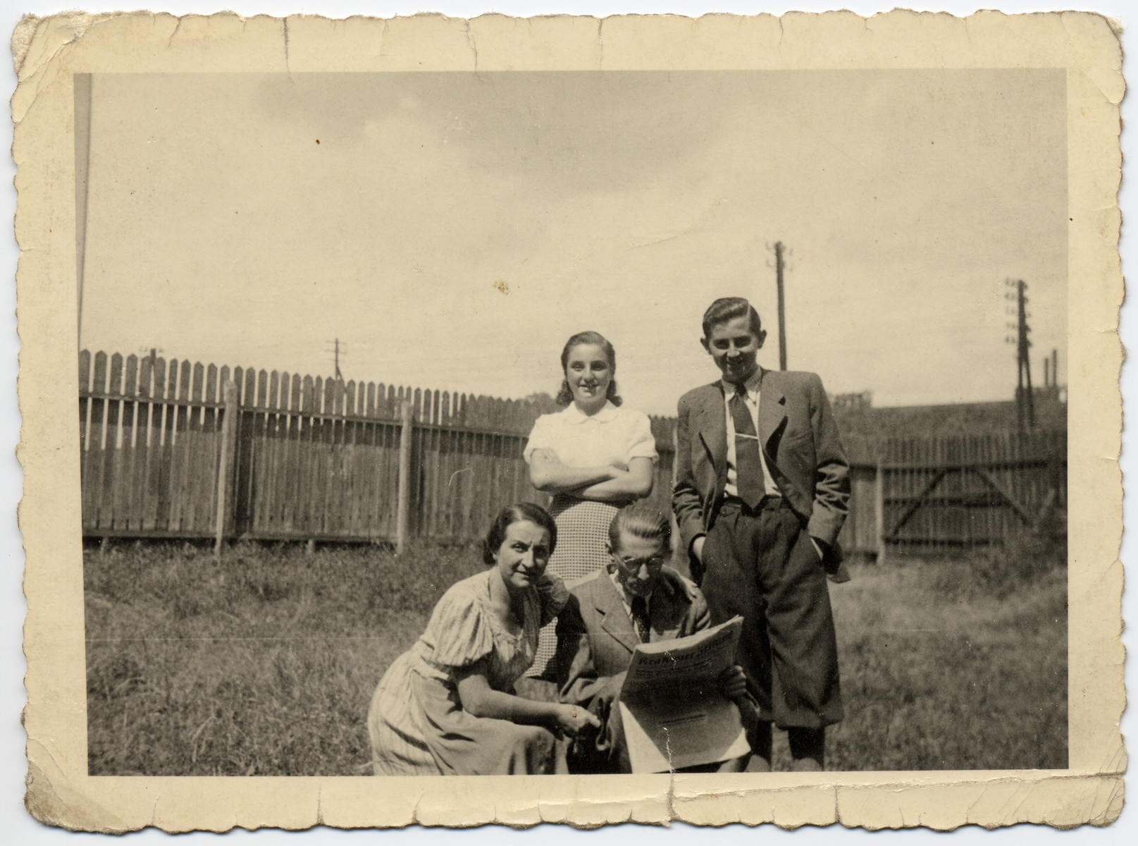 A Jewish Czechoslovak family living in hiding poses for a photograph in a garden in Krakow.   Pictured are Gisela and Leo Kulka with their children Erica and Jan.