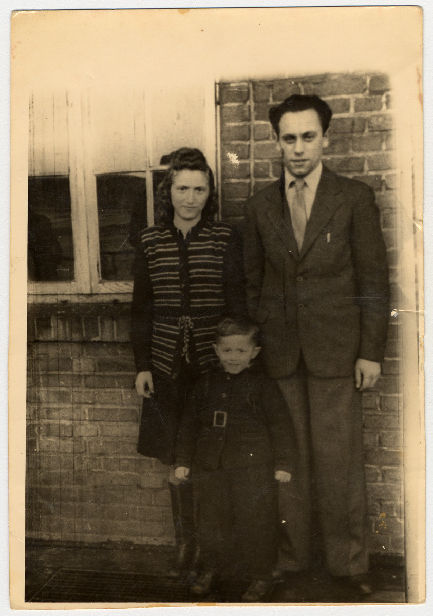 Portrait of a Jewish couple and their young son in the Poppendorf displaced persons' camp.  Pictured are Mania, Mendel and Avraham Goldband.