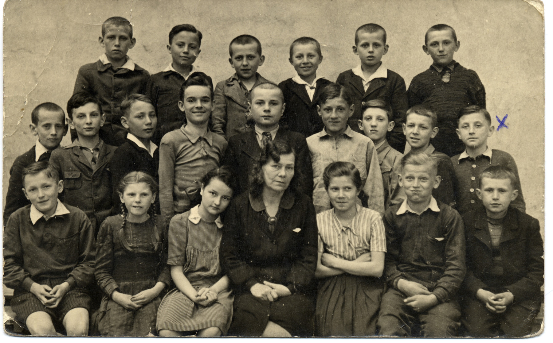 Group portrait of Polish students finishing the 6th grade and their teacher.   Among those pictured is the donor, Robert Kulka, (first from the right in the middle row).