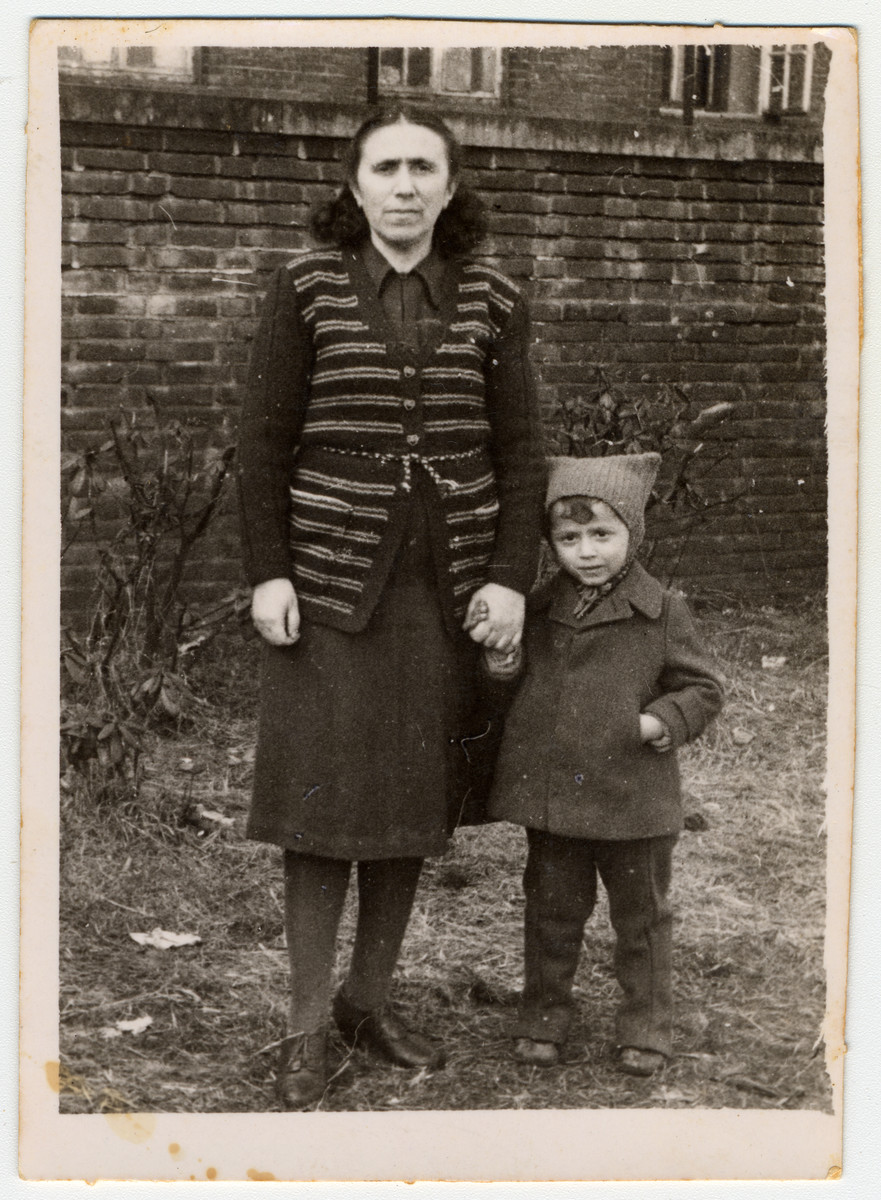 Portrait of a Jewish woman and her young grandson in the Poppendorf displaced persons' camp.  Pictured are Esther Tager and Mendel Goldband.