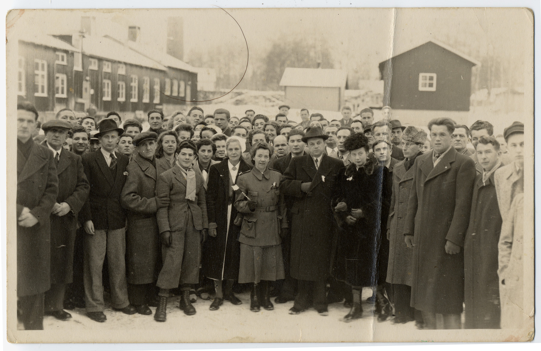 Group portrait of Jewish DPs in a camp in Sweden.   Among those represented is Chaim Kozienicki (fifth from the left in the front row).