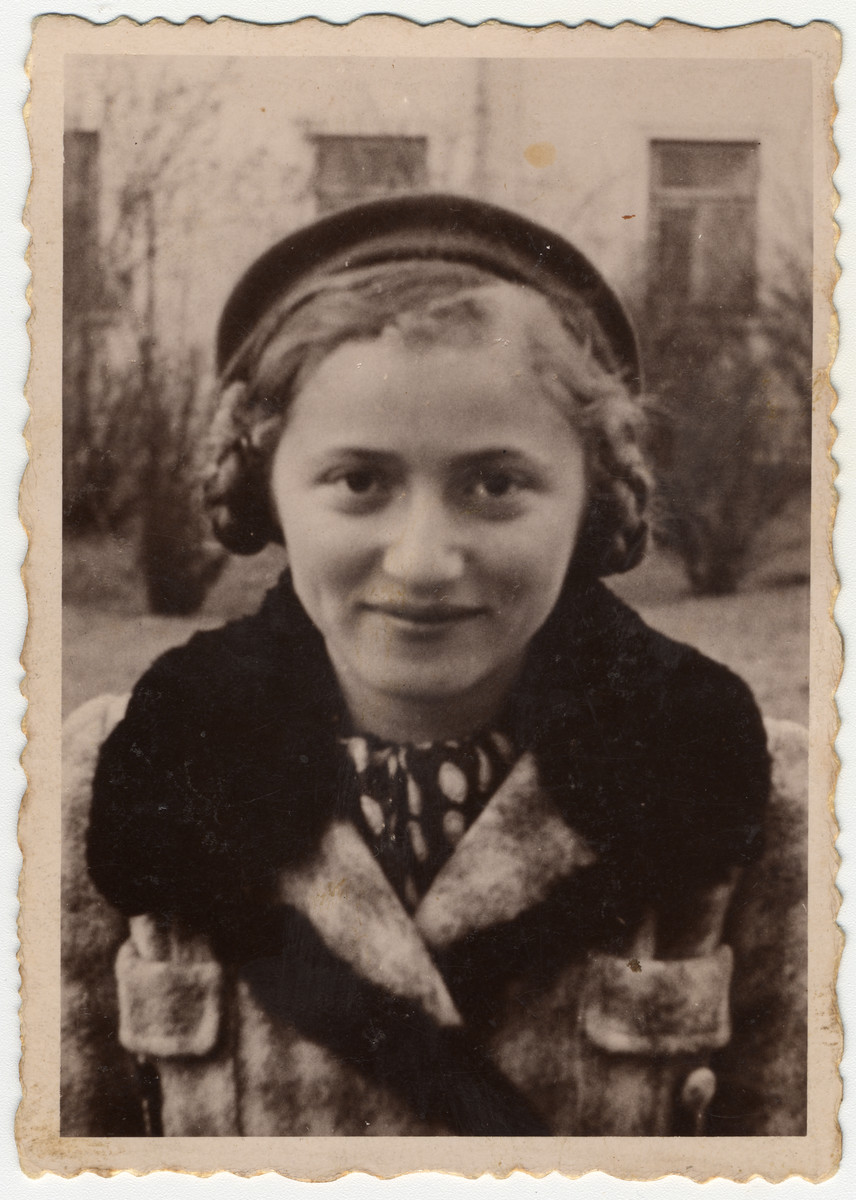 Close-up portrait of a young Jewish woman.  Pictured is Mania Tager.