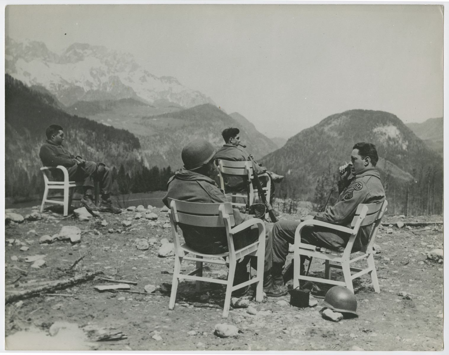 Five soliders of the Seventh U.S. Army visit the former mountain retreat of Adolf Hitler in the Berchtesgaden on the first day of peace in Europe.