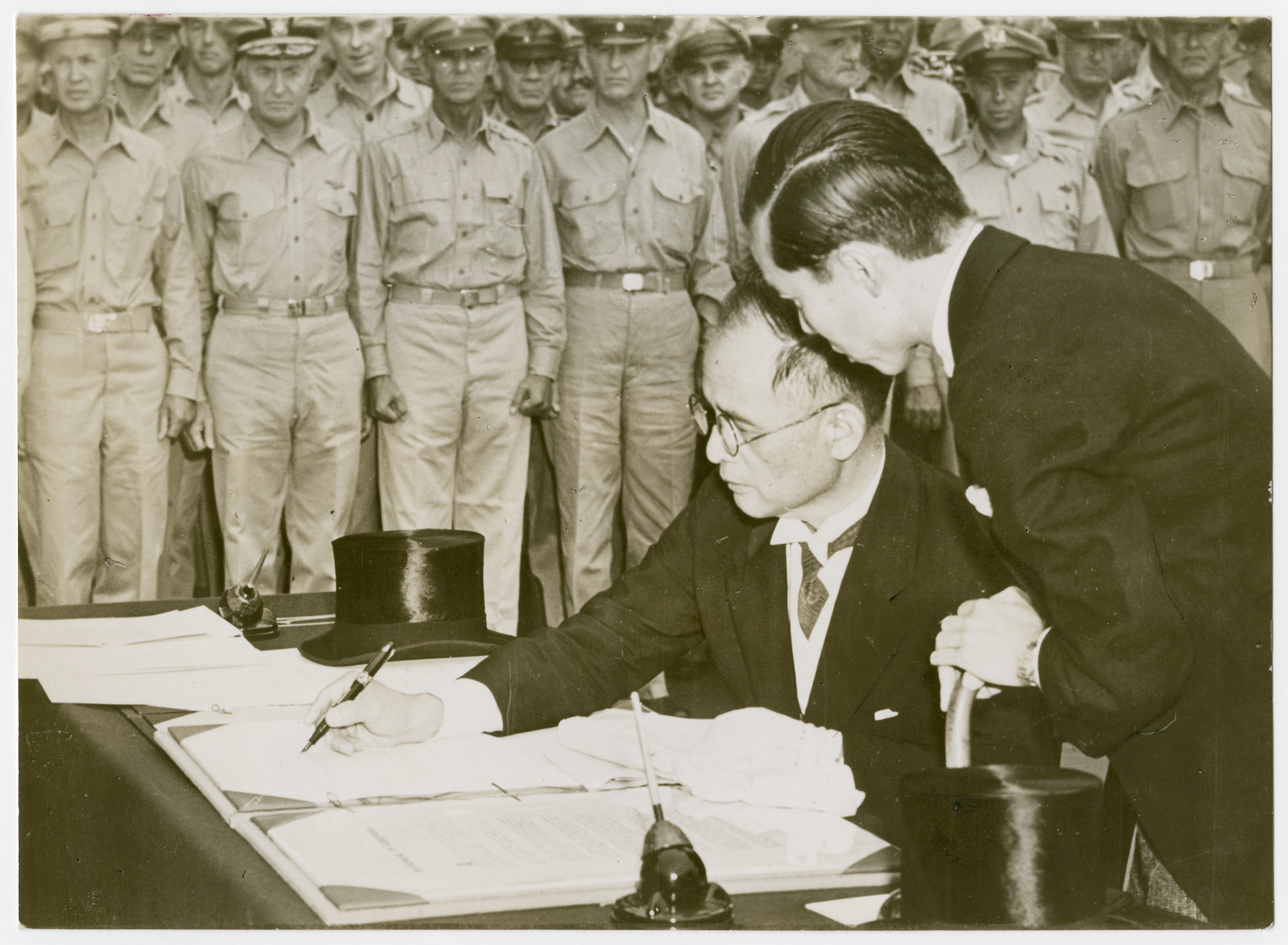 Japanese Foreign Minister, Mamoru Shigemitsu, signs the surrender documents on behalf of his government.  The formal capitulation ceremonies took palce aboard the U.S. battleship Missouri in Tokyo Bay, south of Japan's capital on Sept. 1, 1945.